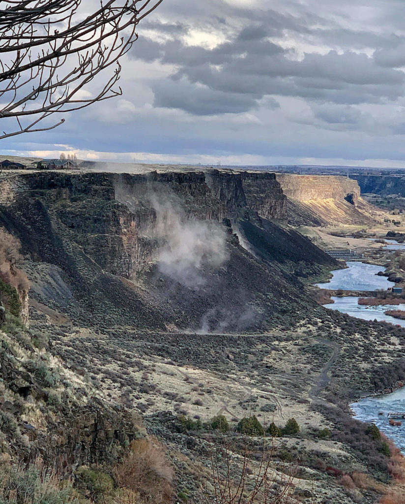 Rocks fall from the north side of the Snake River Canyon near Twin Falls, Idaho, during an earthquake Tuesday. (Israel Bravo via AP)