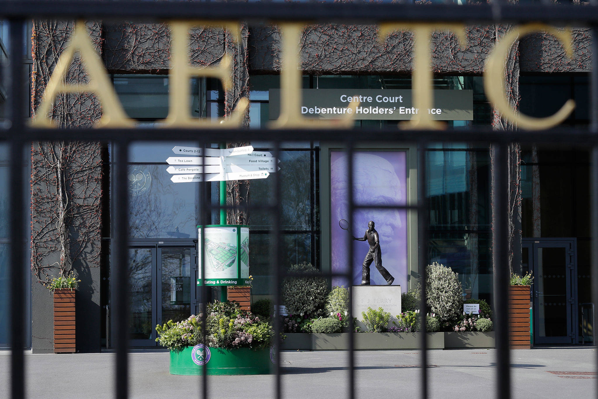 One of the main public entrances to All England Lawn Tennis and Croquet club in London where the Wimbledown tournament is held. (AP Photo/Kirsty Wigglesworth)