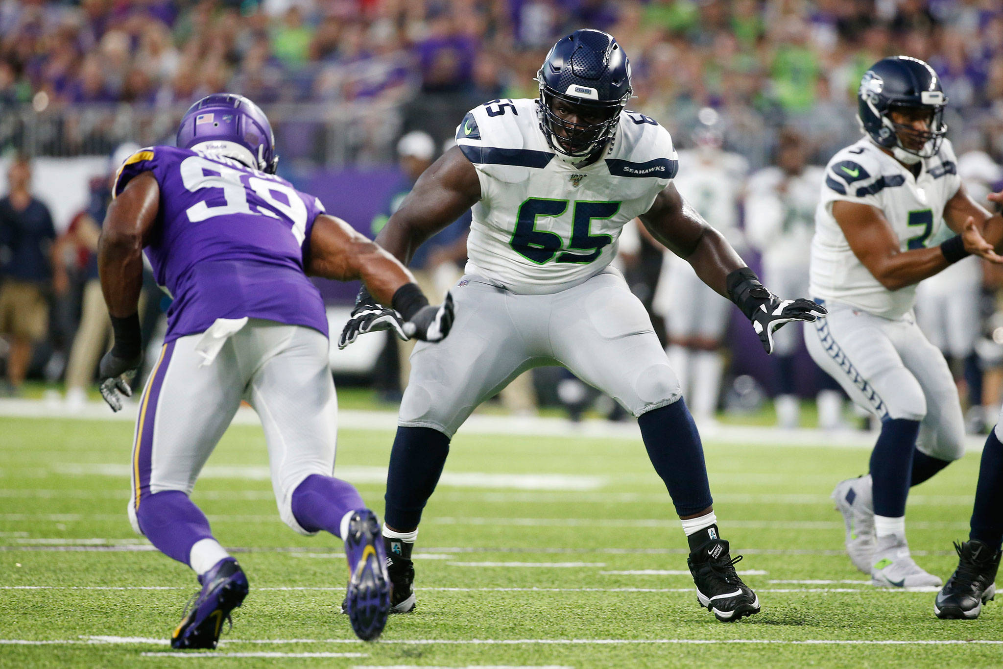 Seahawks tackle Germain Ifedi (65) looks to block Vikings defensive end Danielle Hunter during a preseason game on Aug. 18, 2019, in Minneapolis. Ifedi agreed to a free-agent deal with the Bears on March 25. (AP Photo/Bruce Kluckhohn)
