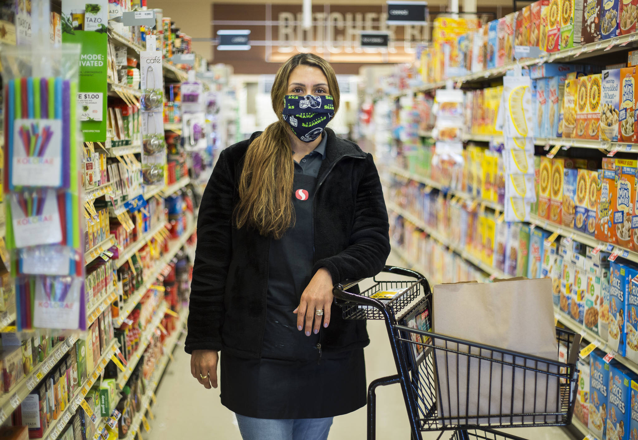 Essential worker Amber Rodriguez is a store clerk at the Silver Lake Safeway in Everett. (Olivia Vanni / The Herald)