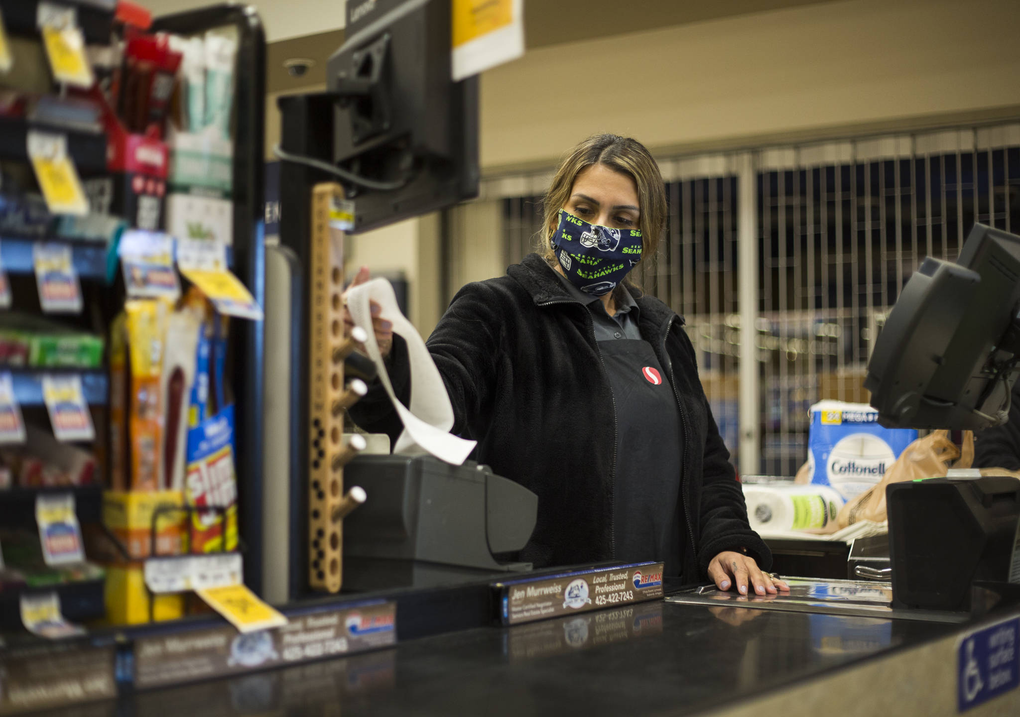 Amber Rodriguez checks out a customer at the Silver Lake Safeway in Everett. (Olivia Vanni / The Herald)