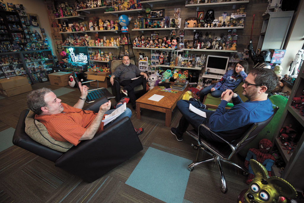 Surrounded by the company's products, Funko Creative Director Sean Wilkinson (left) meets before the coronavirus shutdown with (from left) Eddie Iziarry, Darcy Harlen and Gary Ham. (Andy Bronson / The Herald)