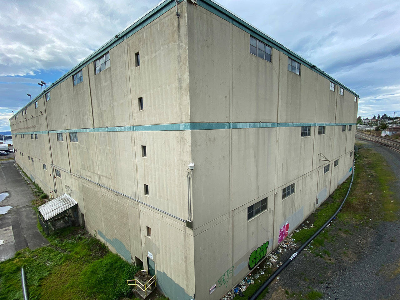 The old Kimberly-Clark warehouse on the Everett waterfront is seen April 29. (Sue Misao / The Herald)
