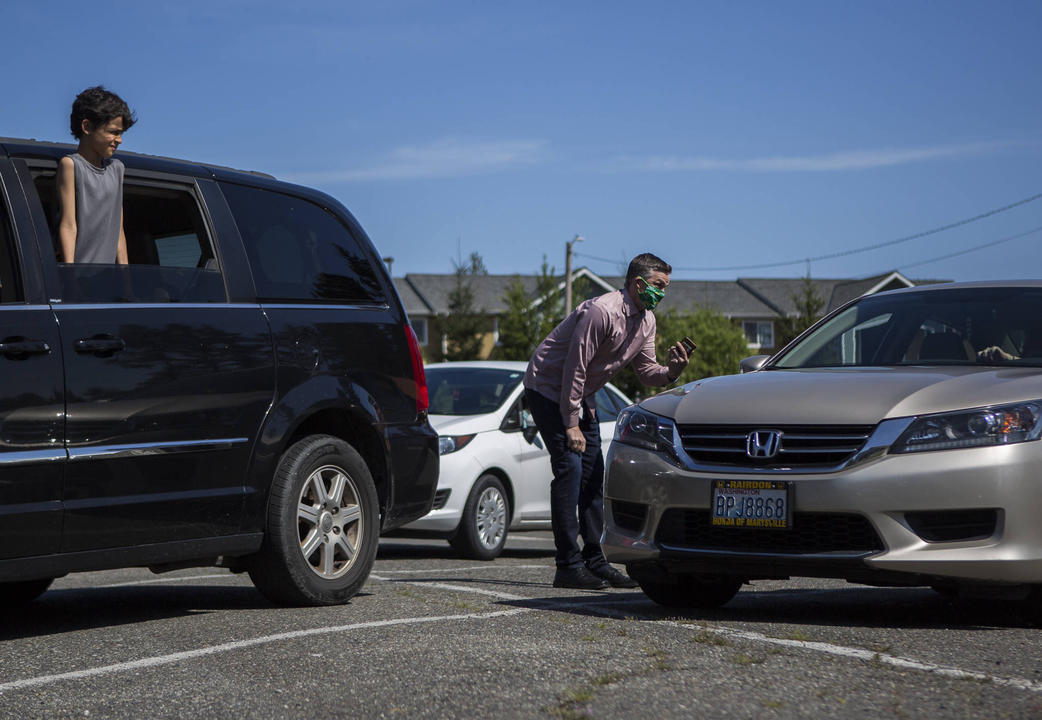 Pastor Aaron Thompson checks in to make sure everyone is connected to the wifi from the parking lot before his service at Marysville Foursquare Gospel Church on Sunday. (Olivia Vanni / The Herald)
