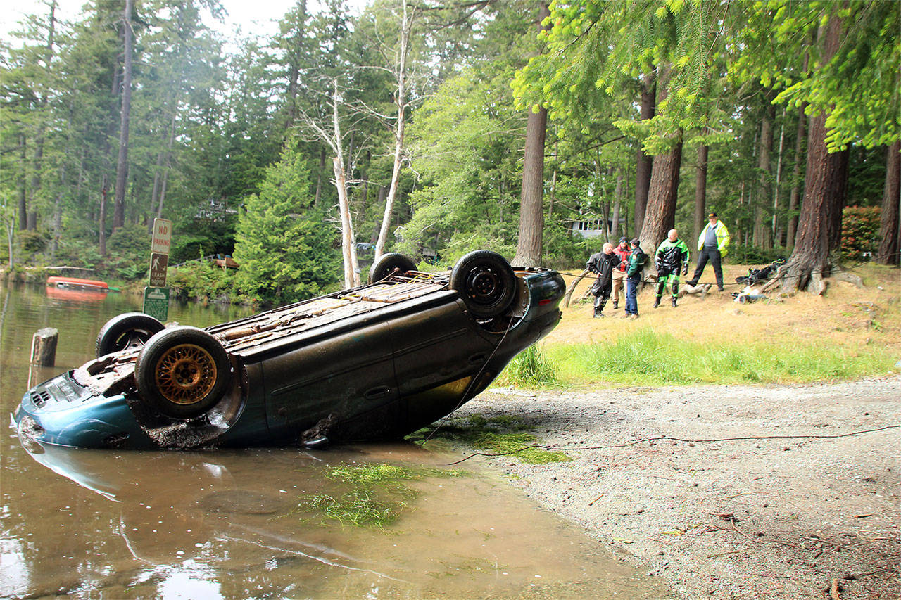 A Ford Taurus was pulled from the muddy depths of Goss Lake on May 21. (Whidbey News-Times)