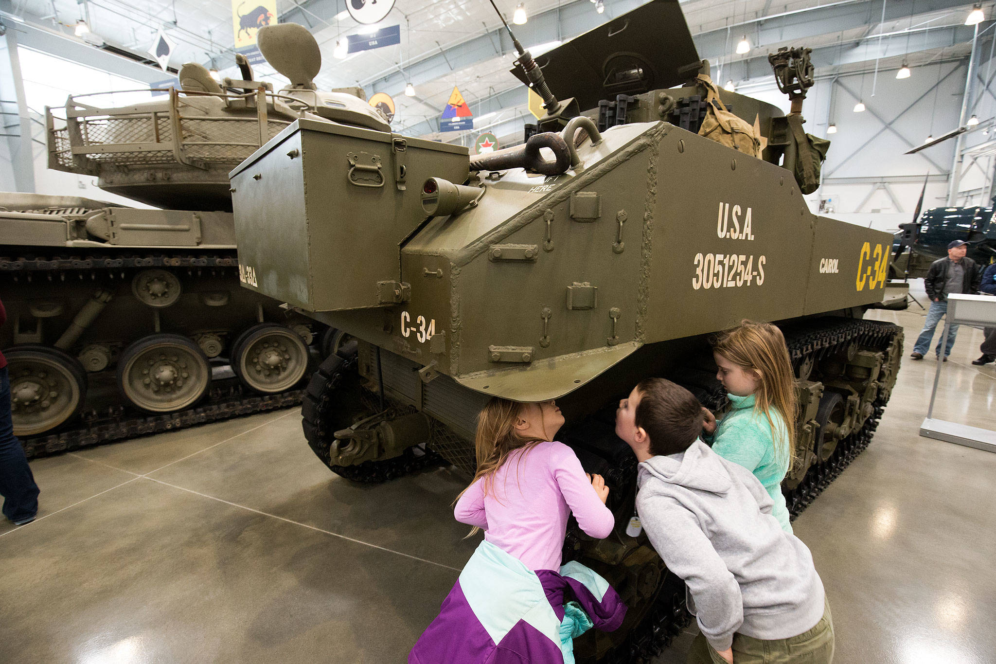 Visitors at the Flying Heritage & Combat Armor Museum at Paine Field in Everett in 2018. (Andy Bronson / The Herald)