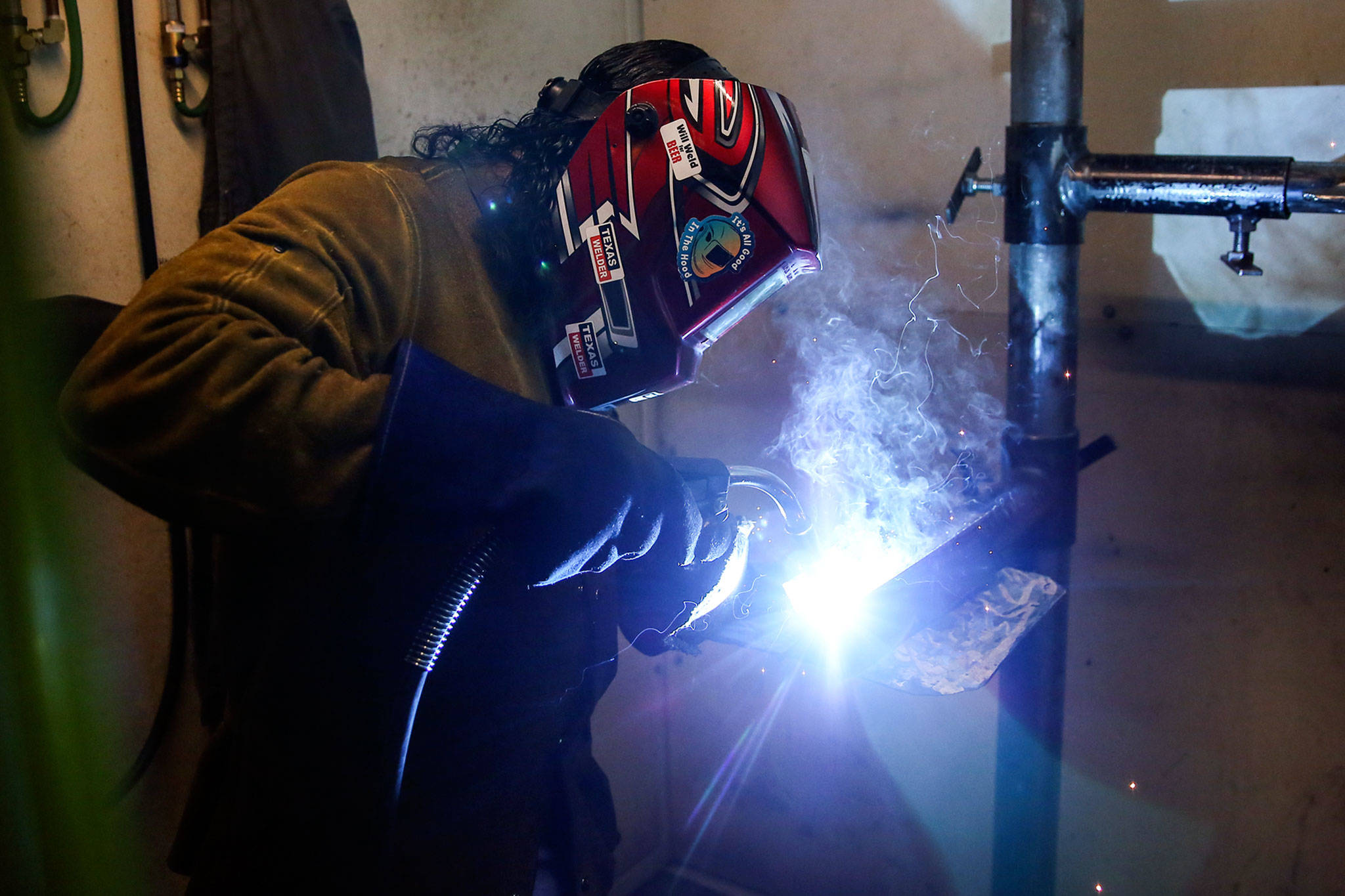 Joesph LaFond works on an assignment at the Advanced Manufacturing Training & Education Center at Everett Community College. (Kevin Clark / The Herald)