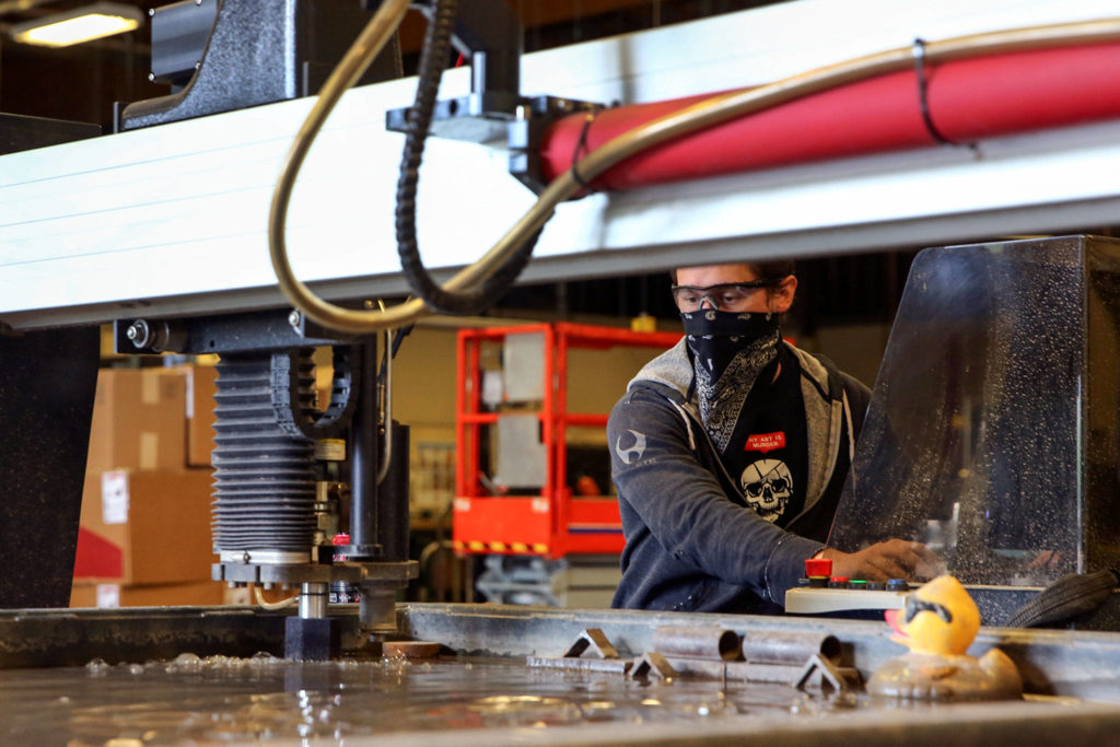 Thomas Zajicek works on an assignment at the Advanced Manufacturing Training & Education Center at Everett Community College. (Kevin Clark / The Herald)