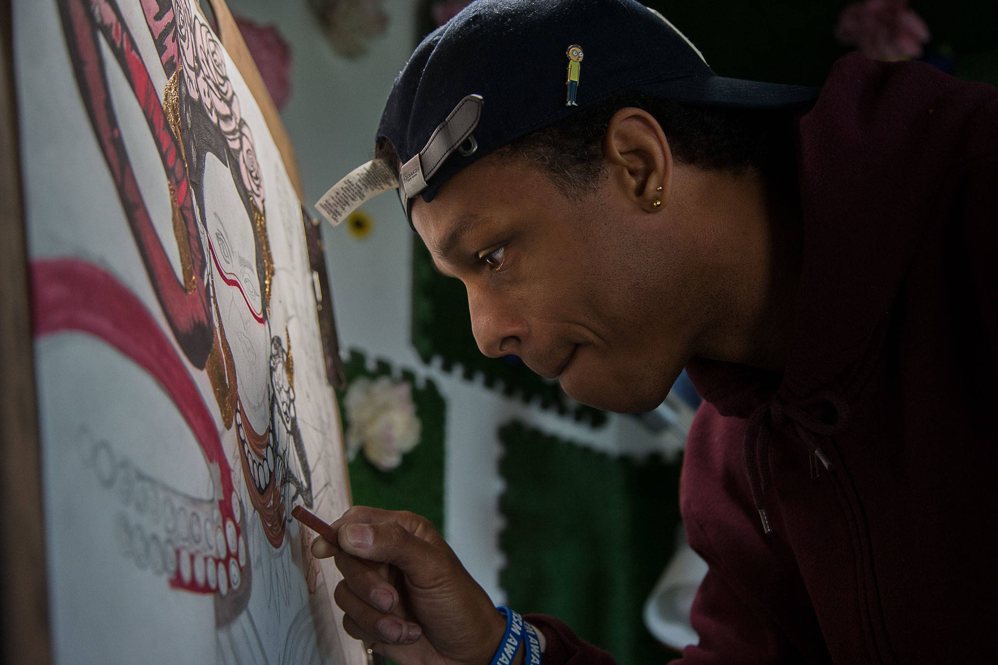 Julius Wilson's artwork can be seen at Zoey's Fried Chicken Sandwiches on Casino Road in south Everett. (Andy Bronson / The Herald)