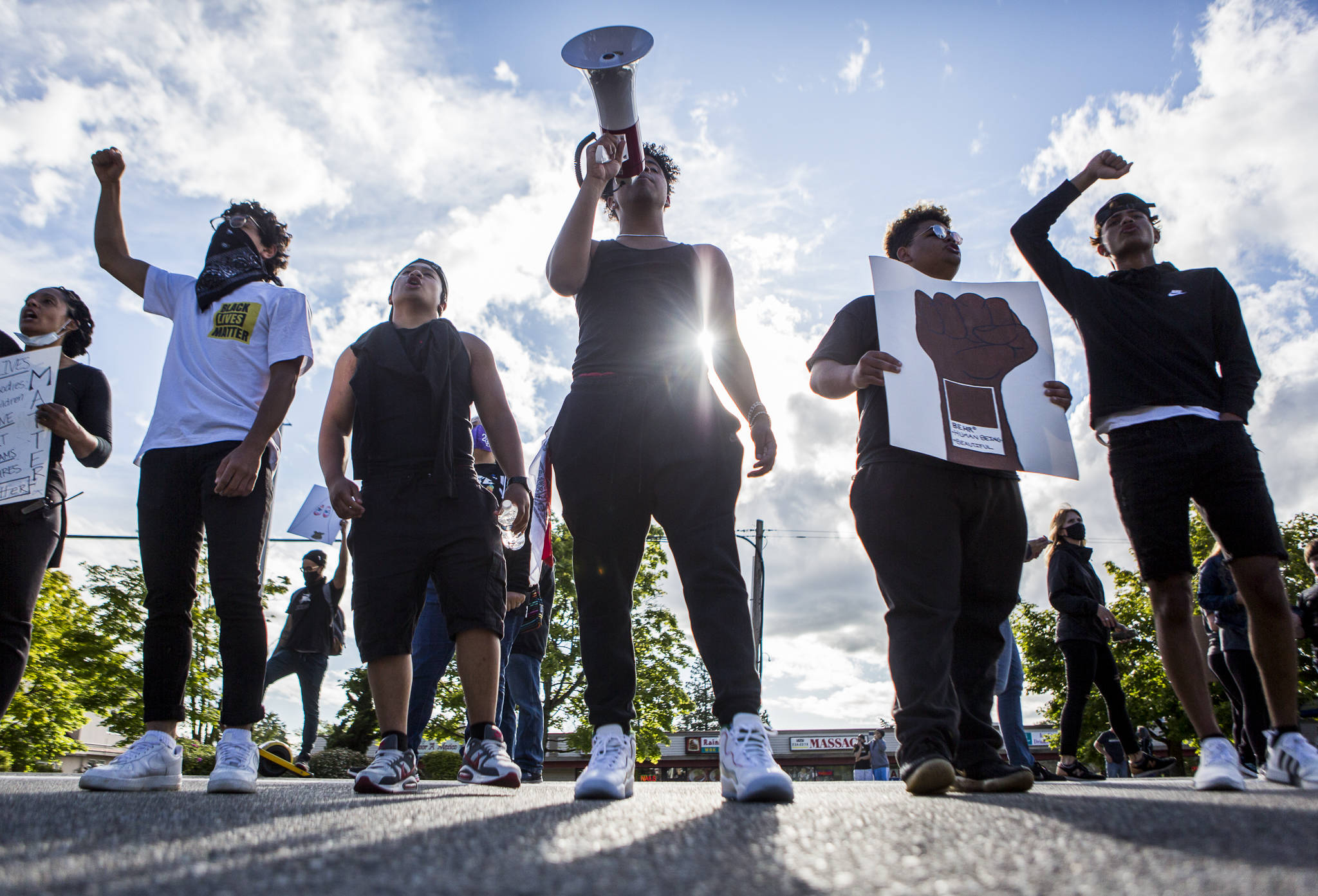 Bilal Jaddi (left to right), Christian Ayson, Keyshon Rife, Daniel Jenkins and Cameron Asinsin lead the crowd in chants as they arrive at the park lot along 84th Street and Mukilteo Speedway during the Black Lives Matter protest on Sunday in Mukilteo. (Olivia Vanni / The Herald)