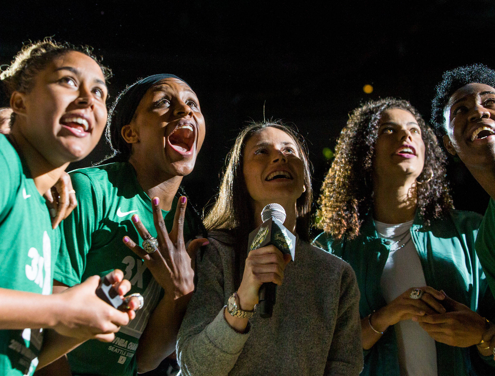 Seattle Storm players (from left) Kaleena Mosqueda-Lewis, Crystal Langhorne, Sue Bird, Alysha Clark and Natasha Howard react to their championship banner being revealed during a pregame ceremony in May 2019 at Angel of the Winds Arena in Everett. Because of the pandemic, the Storm won't be playing any games in Everett this year. (Olivia Vanni / Herald file)