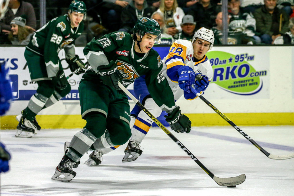 The Silvertips' Brendan Lee controls the puck with the Blades' Matej Toman defending during a game on Nov. 22, 2019, at Angel of the Winds Arena in Everett. (Kevin Clark / The Herald)