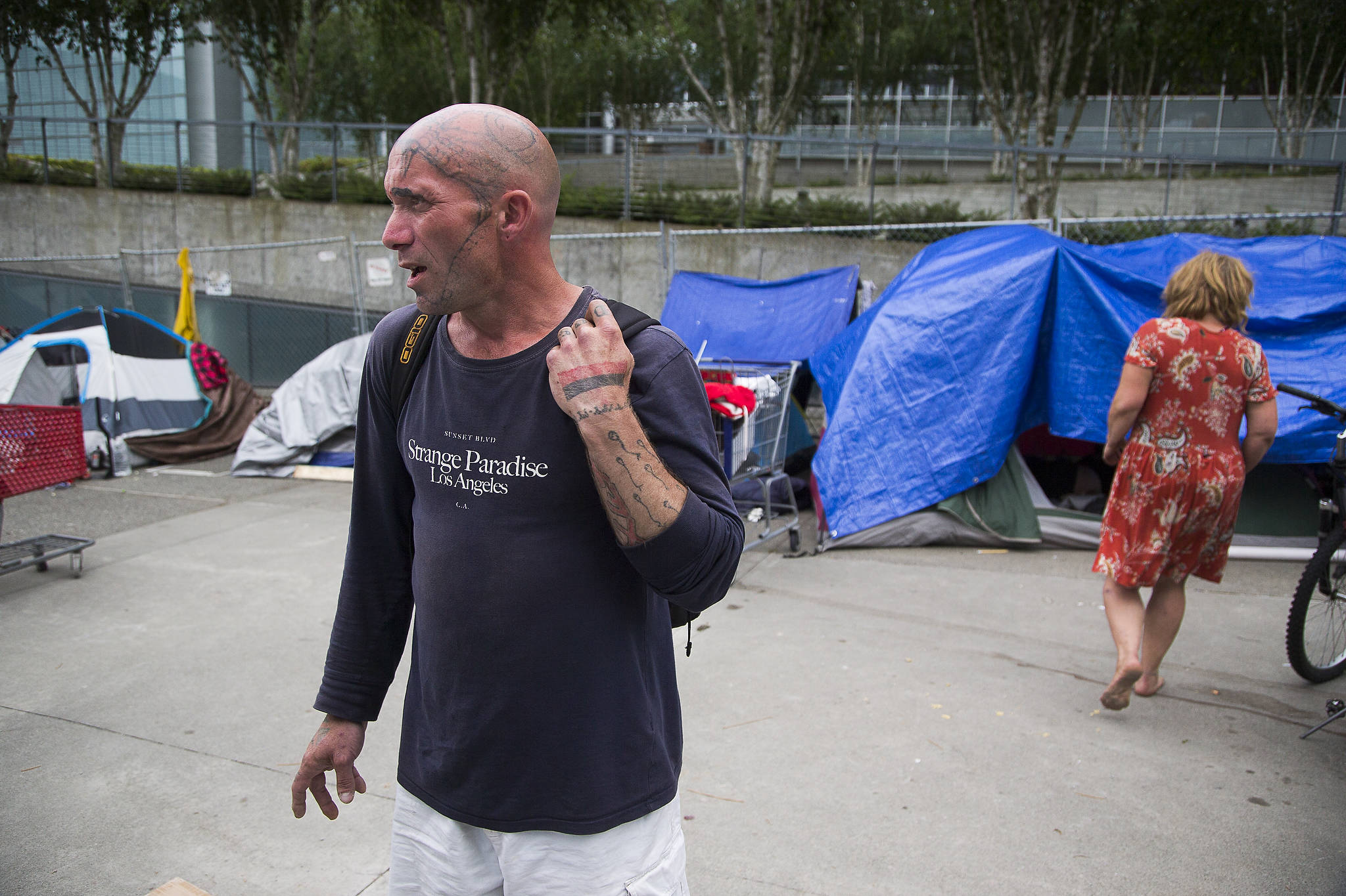 In an encampment for the homeless, Raido Starcloud talks about life on the plaza at Wall Street and Oakes Avenue in Everett. (Andy Bronson / The Herald)