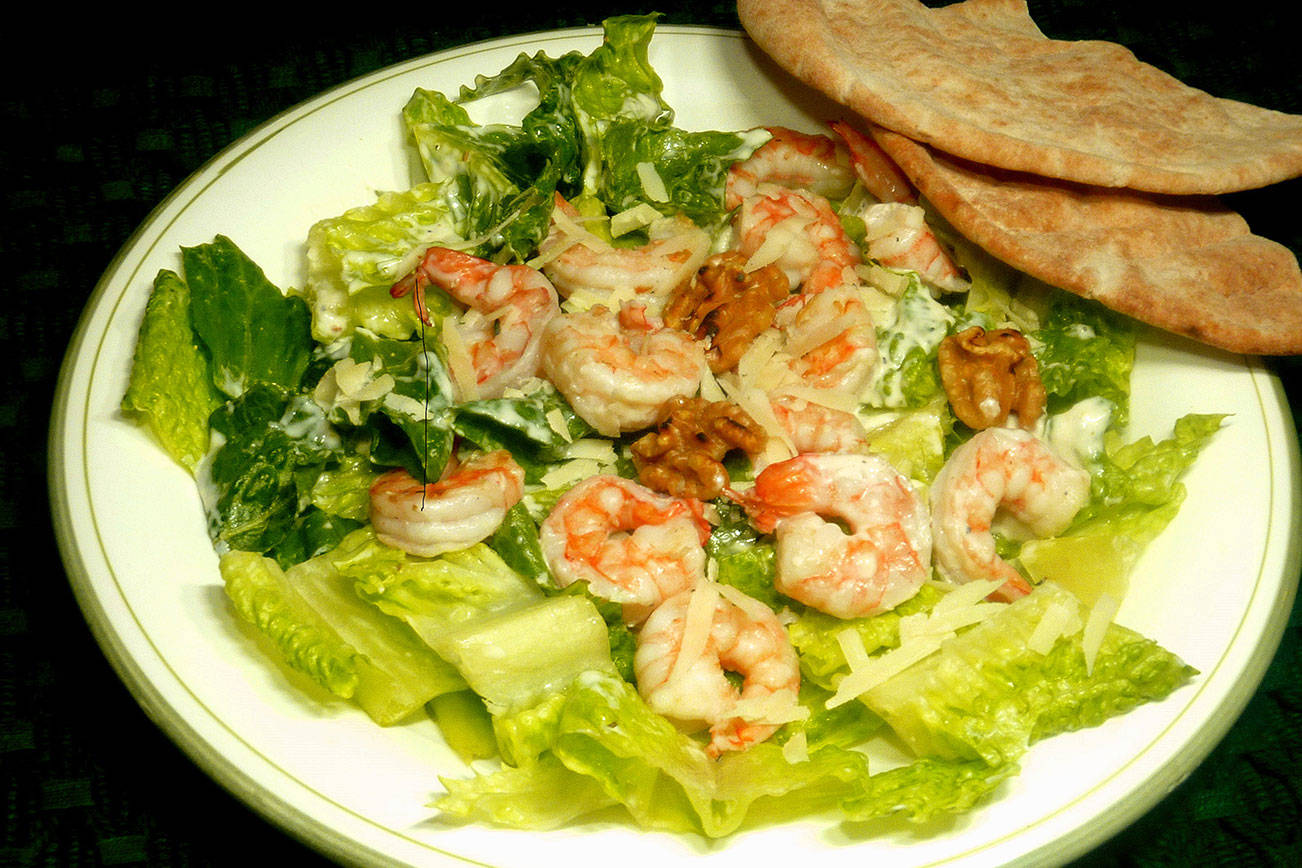 Elevate classic the Caesar salad with grilled shrimp, walnuts