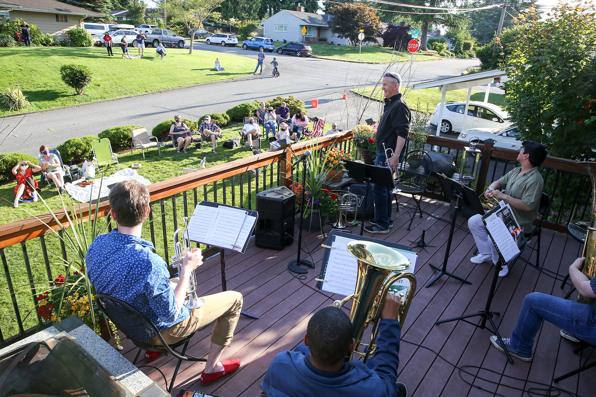 Jake Bergevin introduces musicians during the Thursday night concert in Everett on June 25, 2020. (Kevin Clark / The Herald)