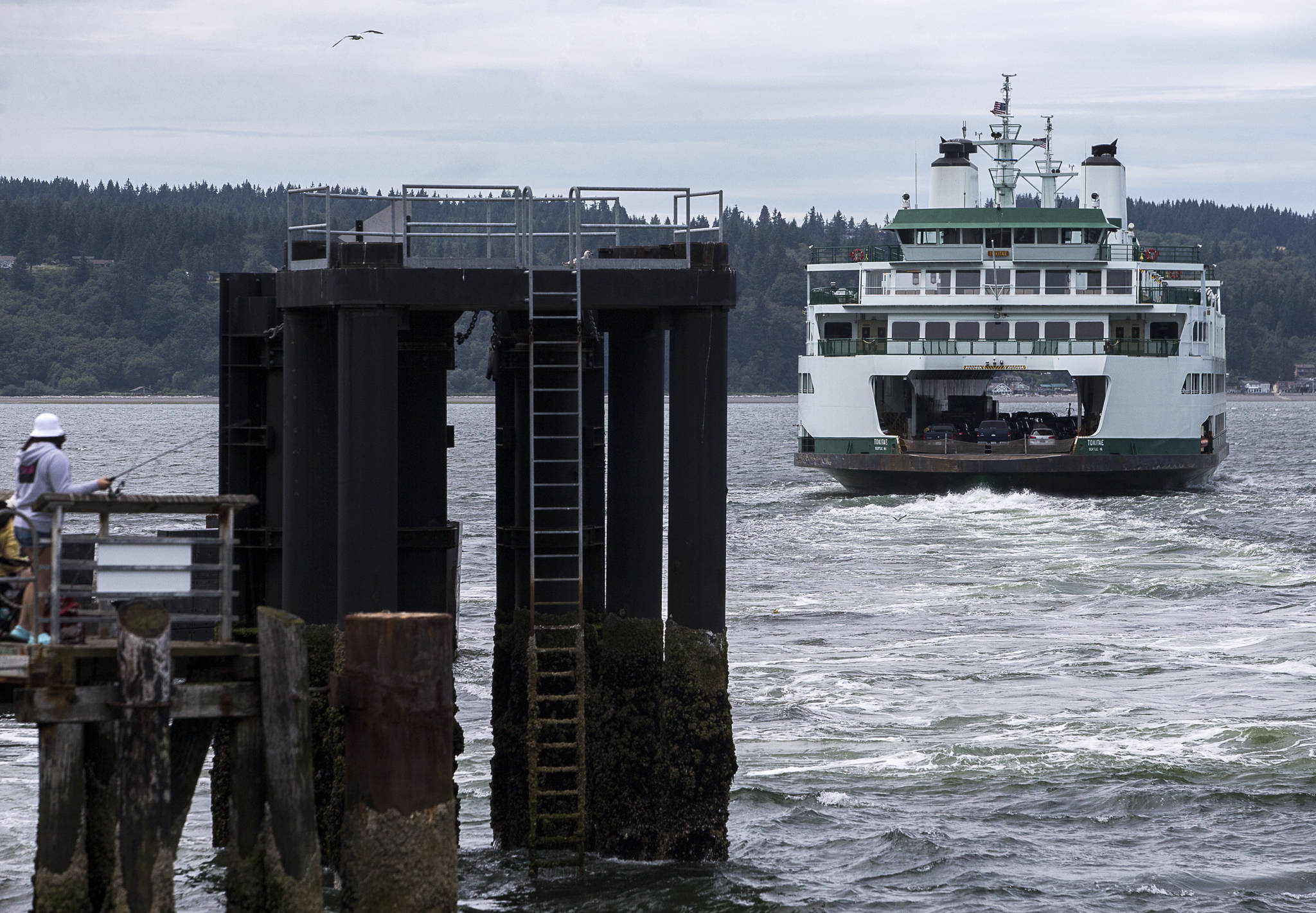A ferry pulls away from the dock in Mukilteo last Friday. (Olivia Vanni / The Herald)