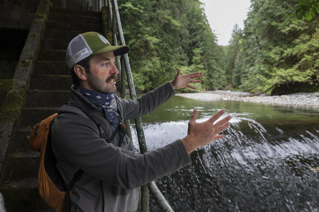 Brett Shattuck, a restoration ecologist with the Tulalip Tribes, at the Pilchuck River in Granite Falls. (Andy Bronson / The Herald)