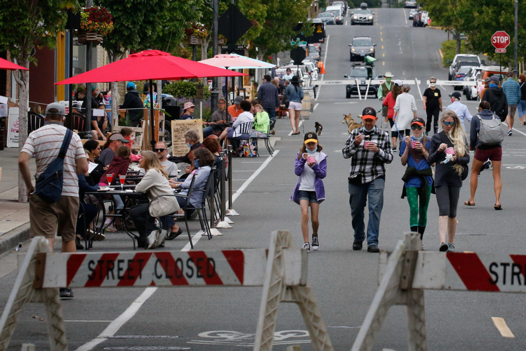 Walkable Main Street, which launched June 20, will continue on Saturdays and Sundays in Edmonds for the foreseeable future. (Kevin Clark / The Herald)