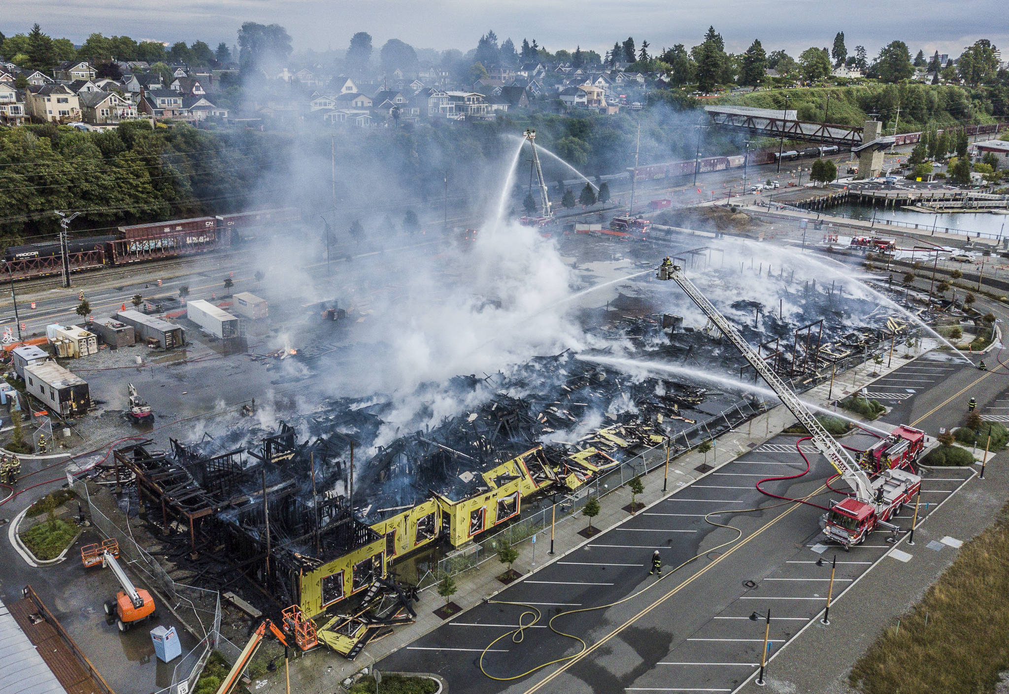 Smoke rises from the under-construction Waterfront Place Apartments that caught fire along Marine View Drive on Thursday in Everett. (Olivia Vanni / The Herald)