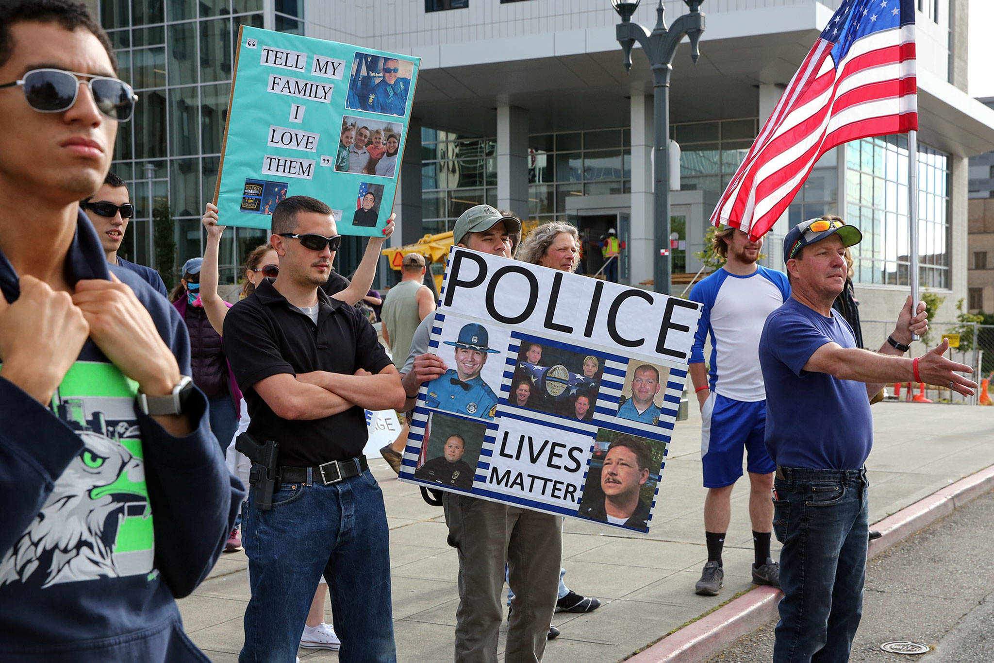 Supporters of law enforcement and first responders rally confront counter protesters Friday at the Snohomish County Plaza in Everett on July 17, 2020. (Kevin Clark / The Herald)