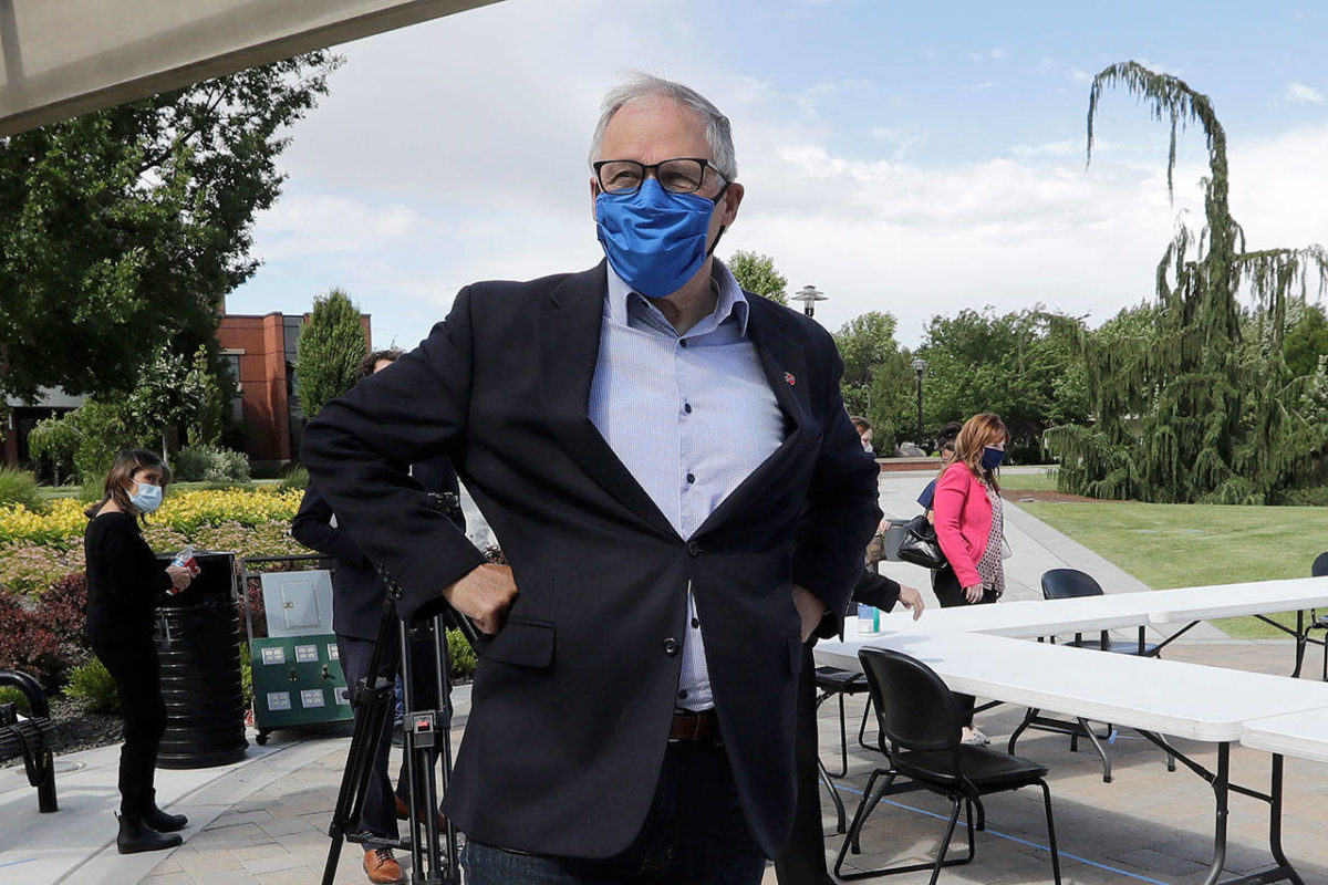 In this June 16 photo, Washington state Gov. Jay Inslee talks about the coronavirus outbreak following a briefing at Yakima Valley College. (AP Photo/Elaine Thompson, file)
