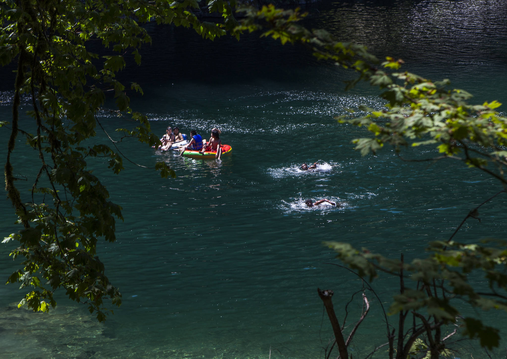 People float and swim at Eagle Falls on Wednesday in Index. (Olivia Vanni / The Herald)