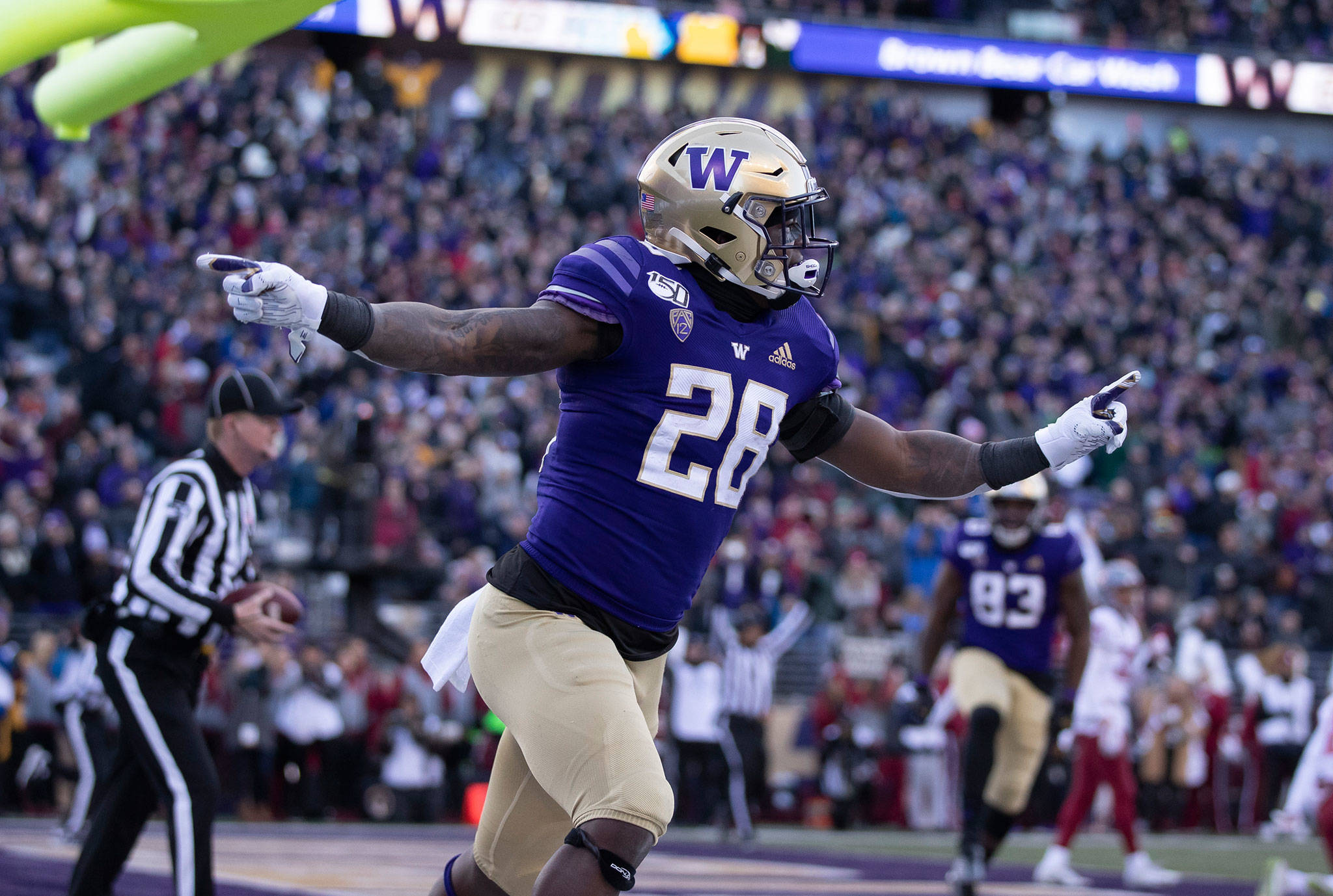Washington running back Richard Newton celebrates after scoring a touchdown during the first half of the Apple Cup against Washington State on Nov. 29, 2019 in Seattle. (AP Photo/Stephen Brashear)