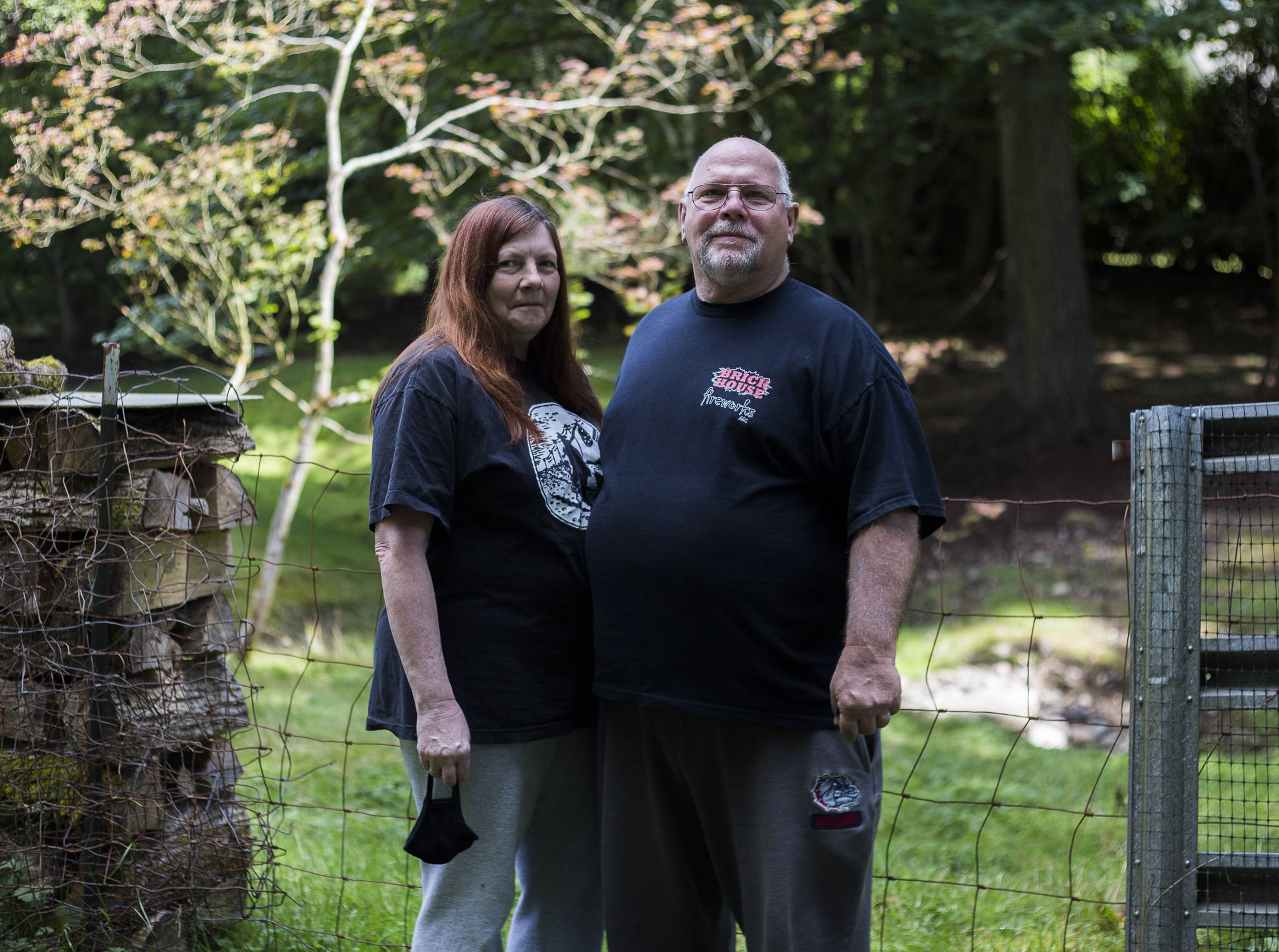 Sandy Lambertson (left) and husband Doug at their home in Lake Stevens. (Olivia Vanni / The Herald)