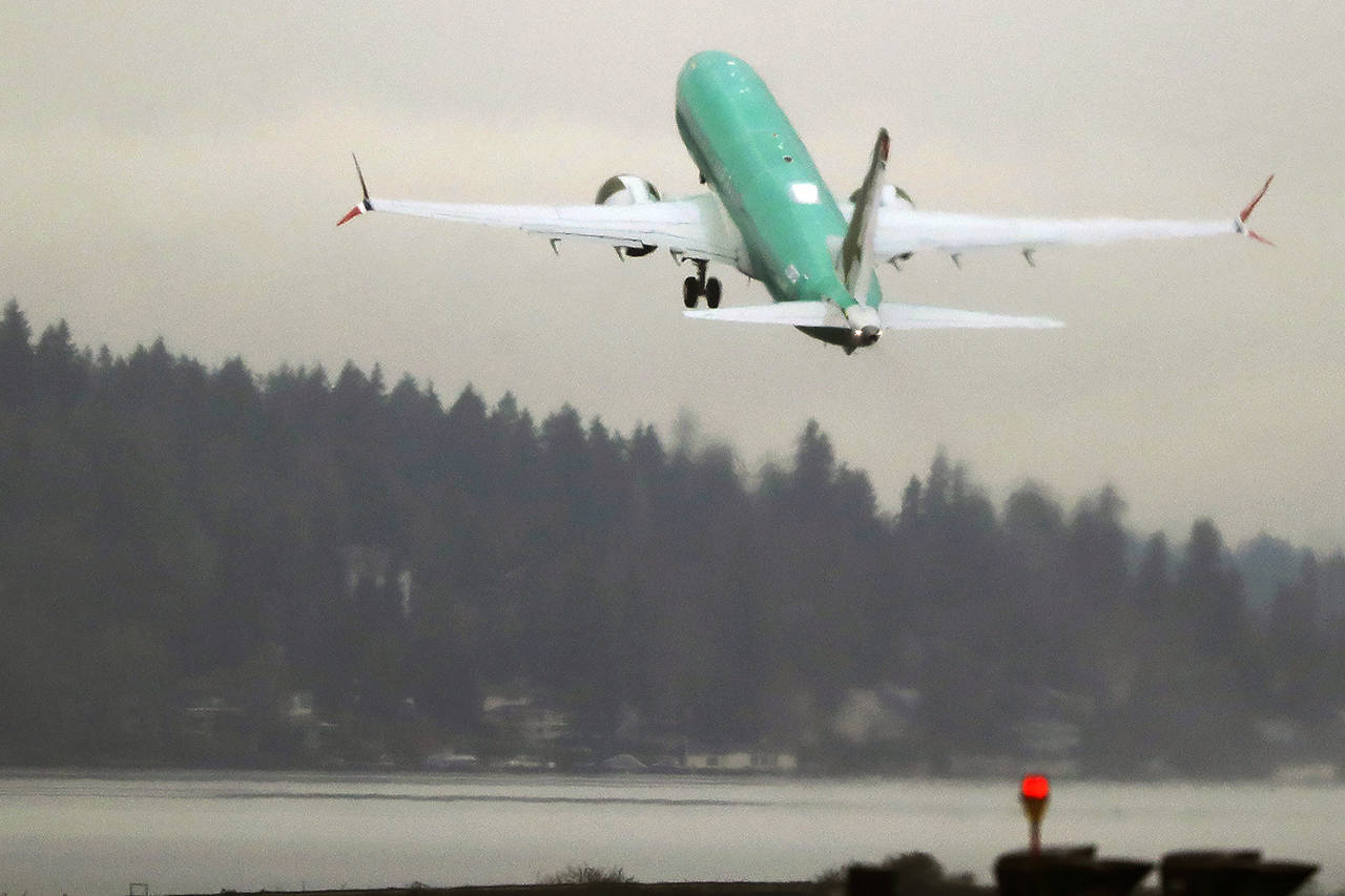 A Boeing 737 Max airplane takes off on a test flight Dec. 11, 2019, from Renton Municipal Airport. (AP Photo/Ted S. Warren)