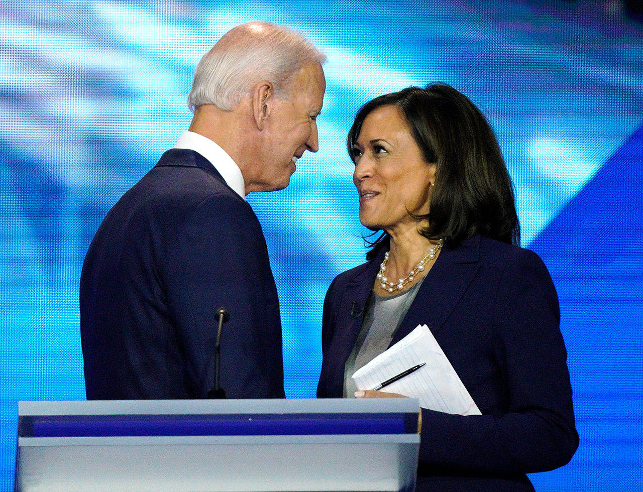 Democratic presidential candidate and former Vice President Joe Biden (left) and then-candidate Sen. Kamala Harris, D-Calif., shake hands after a Democratic presidential primary debate last September. (AP Photo/David J. Phillip, File)