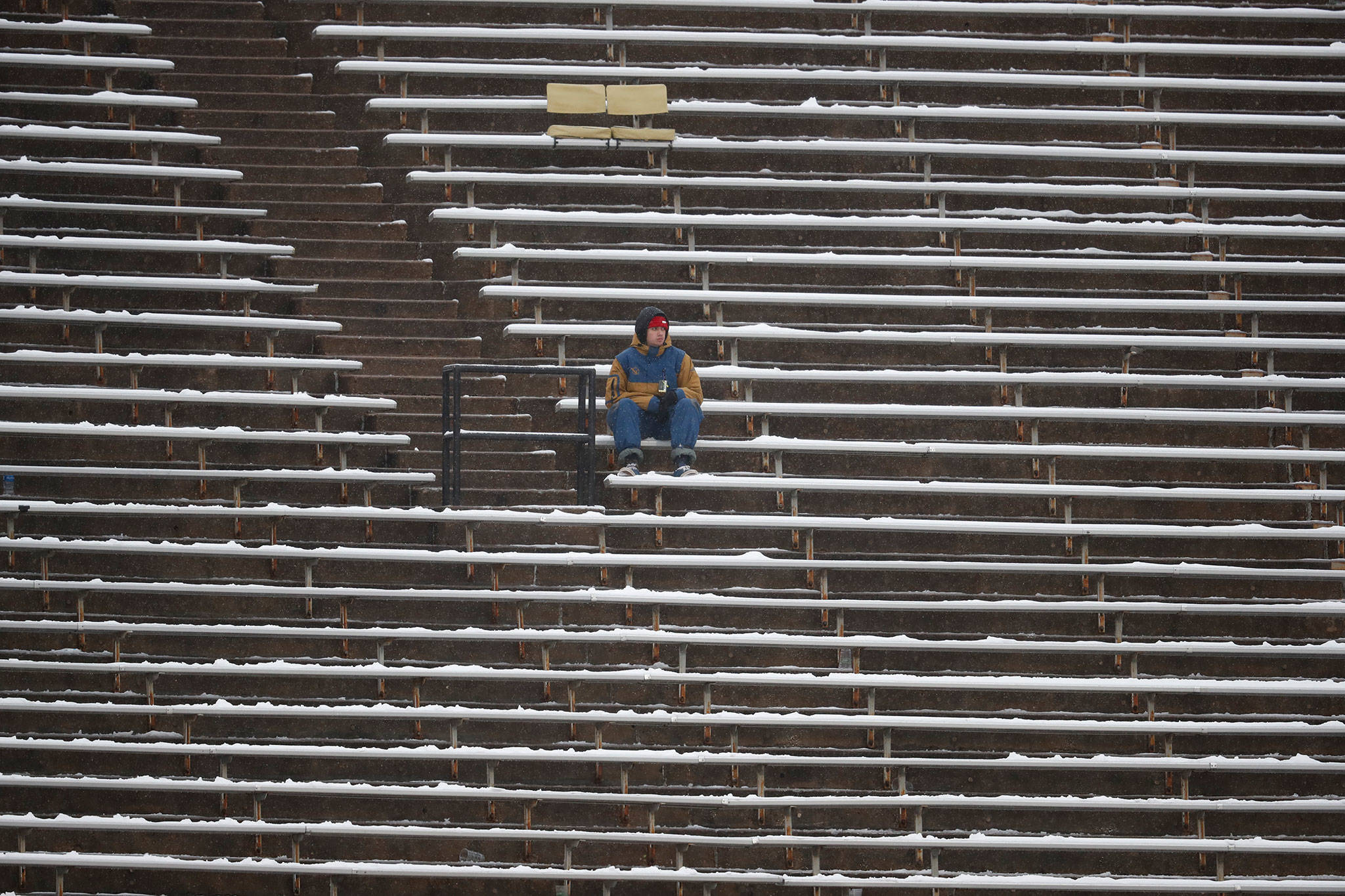A lone fan sits in the stands during a Pac-12 football game in 2018 in Boulder, Colo. (AP Photo/David Zalubowski)