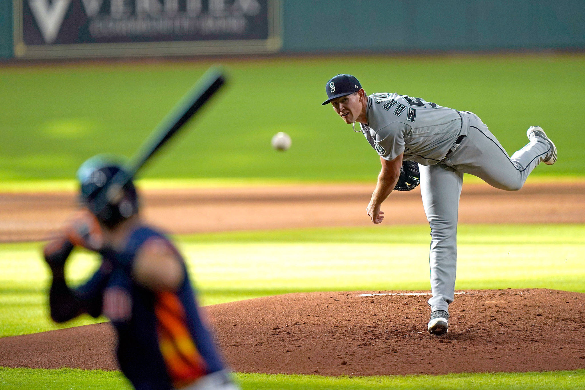 Mariners starting pitcher Nick Margevicius throws to the Astros' Josh Reddick during the first inning of a game Aug. 15, 2020, in Houston. (AP Photo/David J. Phillip)