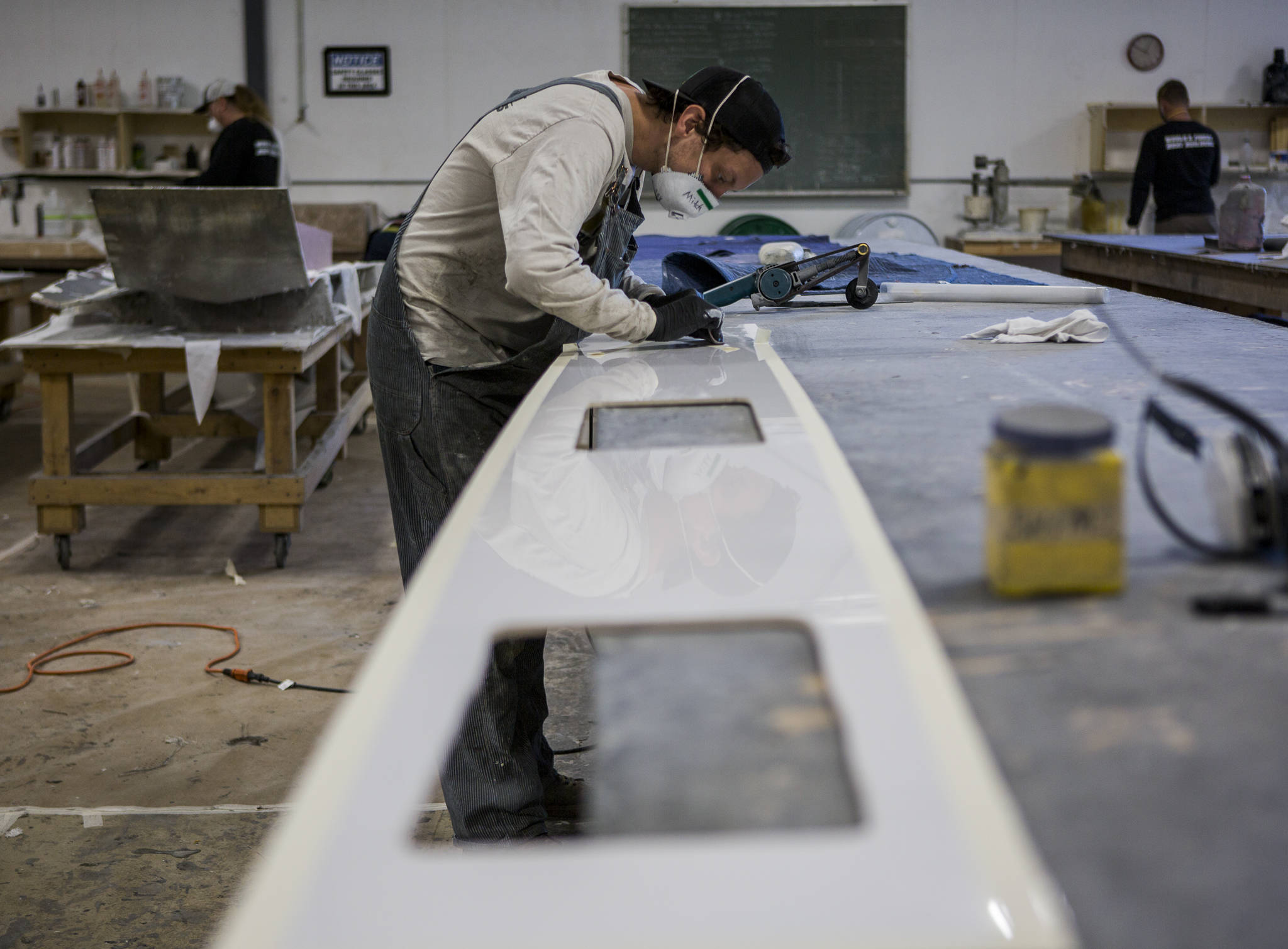 Pocock Racing Shells in Everett depends on college football programs, which are major sources of revenue for less-lucrative sports like rowing. (Olivia Vanni / The Herald)