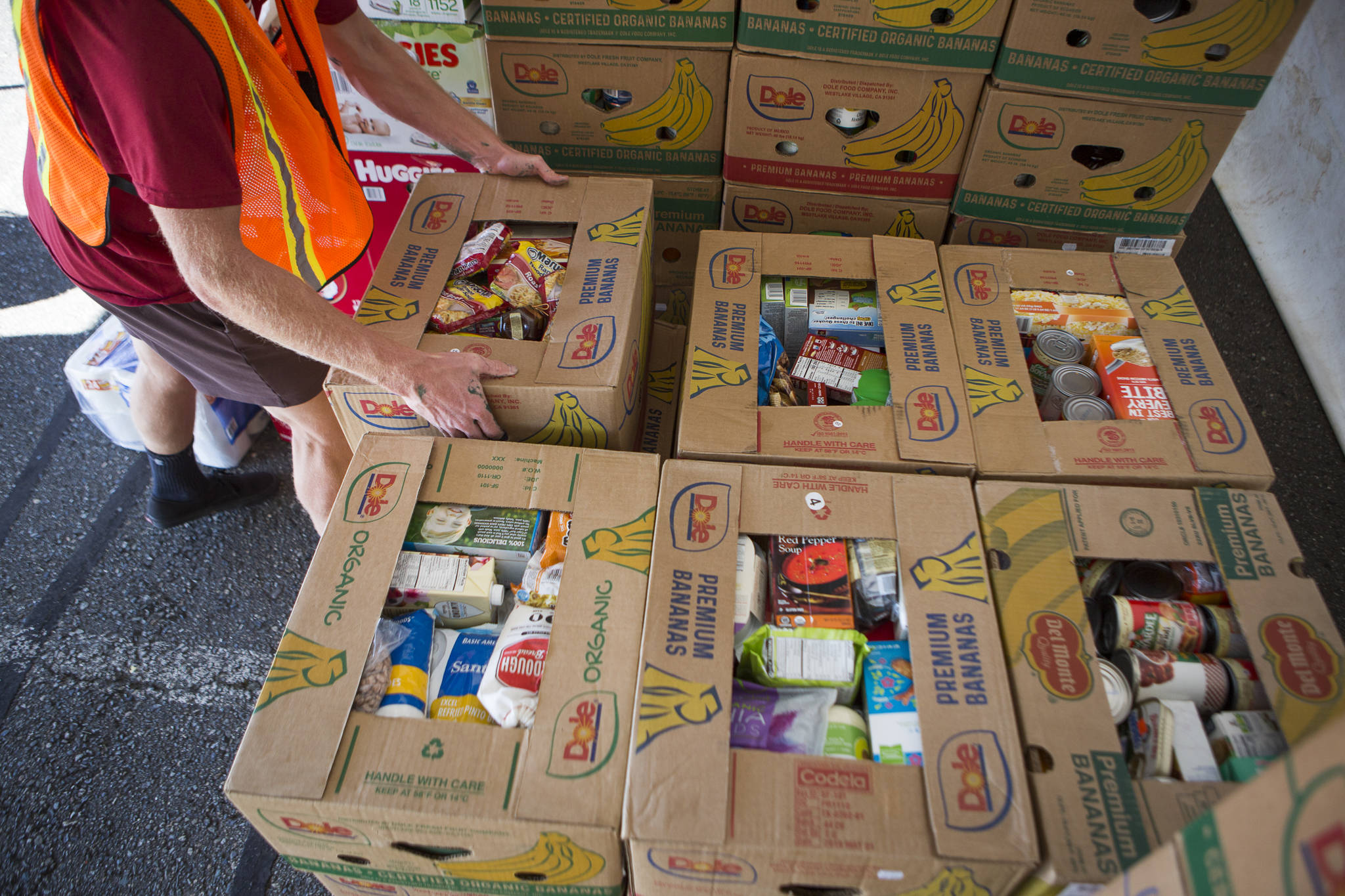 Boxes full of food donations are stacked Thursday during the drive-thru Snohomish County Food Drive in Monroe. (Olivia Vanni / The Herald)