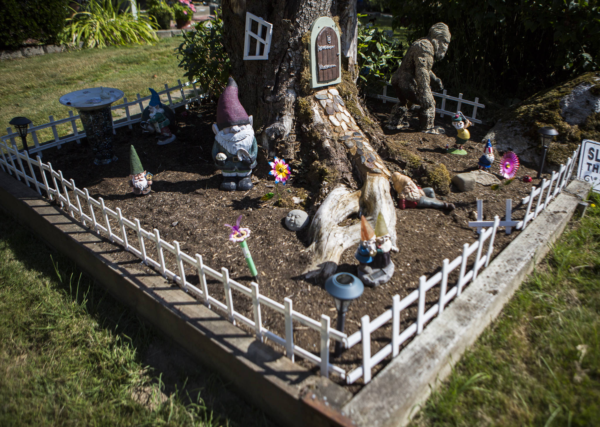 A gnome-size fenced yard surrounds the Cogswells' creation. (Olivia Vanni / The Herald)