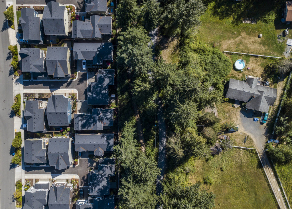 The southern boundary of Timber Creek subdivision, which borders a handful of properties along 43rd Avenue whose owners are hoping for a zoning change. (Olivia Vanni / The Herald)
