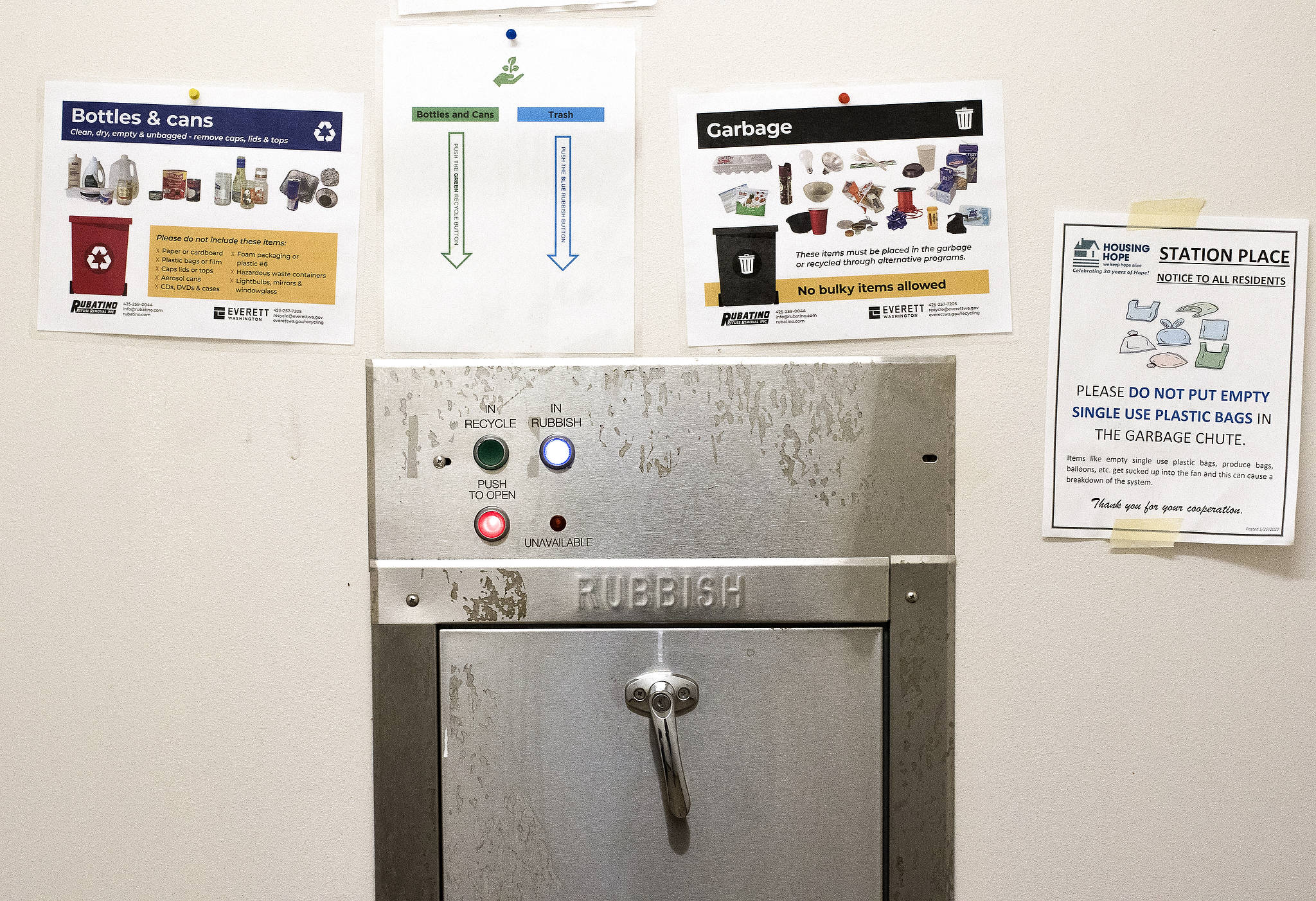 Garbage, recycling and compost are separated by residents by using different buttons for the garbage chute on each level of HopeWorks Station in Everett. (Andy Bronson / The Herald)