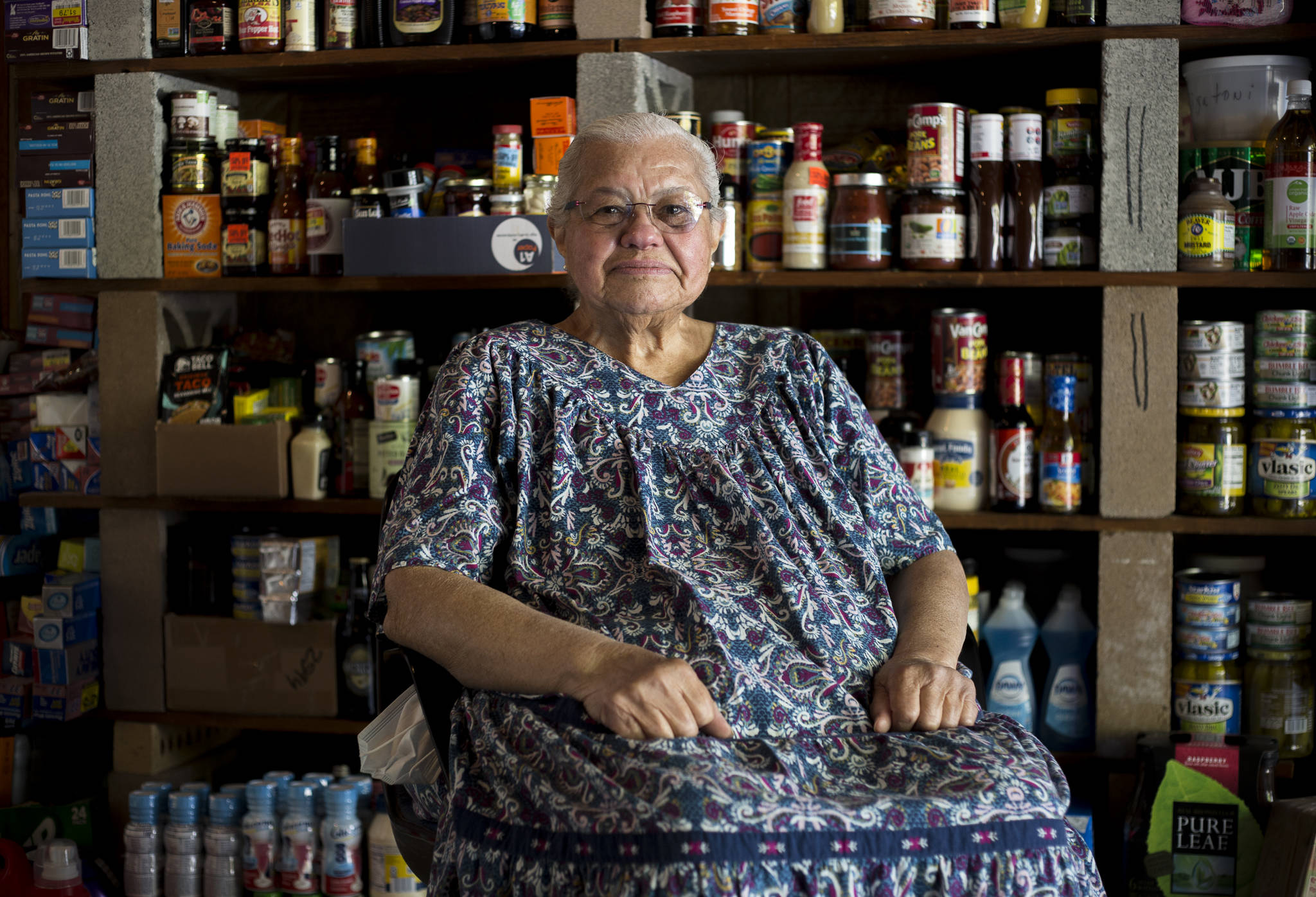 Leanne Aleia, 86, at her Mill Creek home, surrounded by only a fraction of the food she has collected for donation. (Olivia Vanni / The Herald)