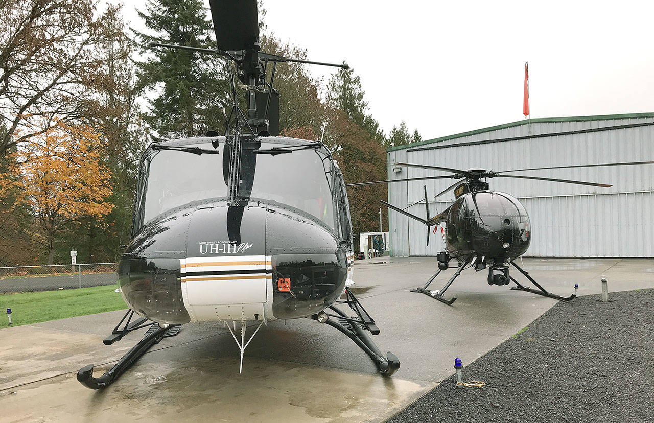 Snohomish County Sheriff's Office helicopters parked at the agency's search-and-rescue headquarters near Snohomish. (Chuck Taylor / Herald file)