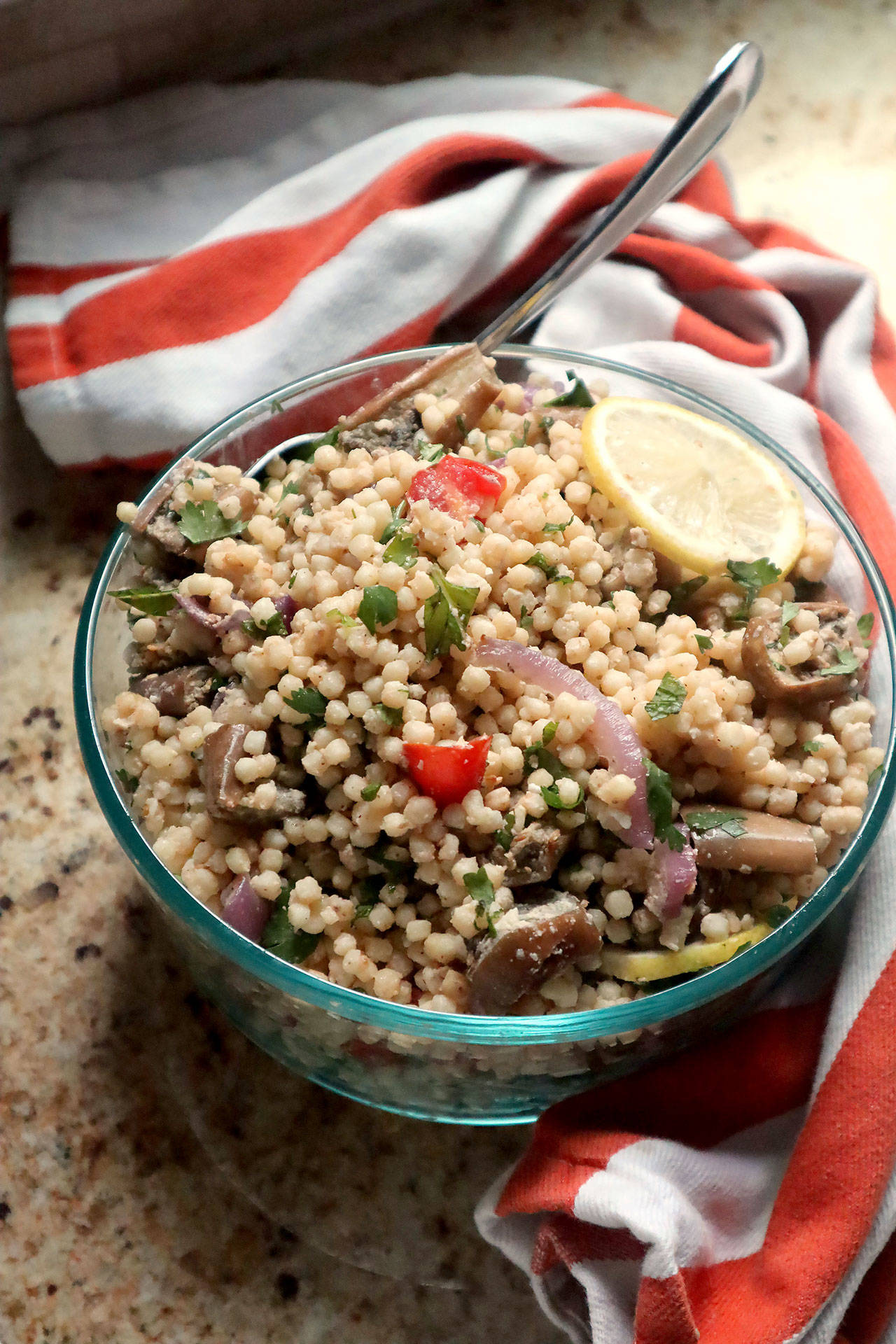 Roasted eggplant is tossed with Israeli couscous, tomatoes, fresh herbs and a lemony tahini dressing. (Gretchen McKay / Pittsburgh Post-Gazette)