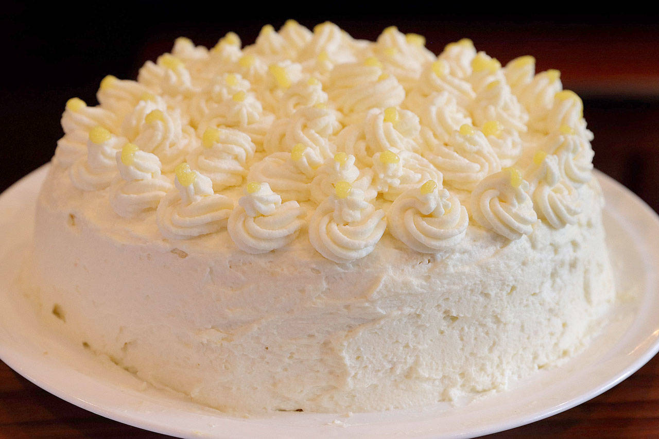 Lemon mascarpone layer cake is a four-layer tower worthy of any restaurant or bakery. (Hillary Levin / St. Louis Post-Dispatch)