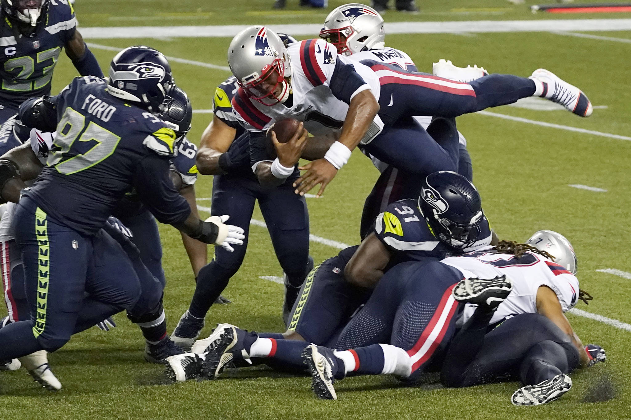 New England Patriots quarterback Cam Newton dives with the ball, but is stopped near the goal line as the clock expires in the fourth quarter of an NFL football game against the Seattle Seahawks last Sunday at CenturyLink Field. The Seahawks won 35-30. (AP Photo/Elaine Thompson)