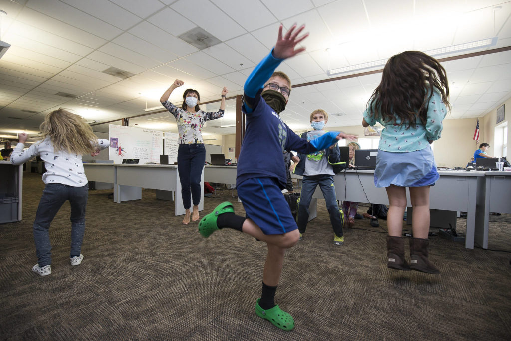 Students get in some physical activity at Electroimpact in Mukilteo. (Andy Bronson / The Herald)