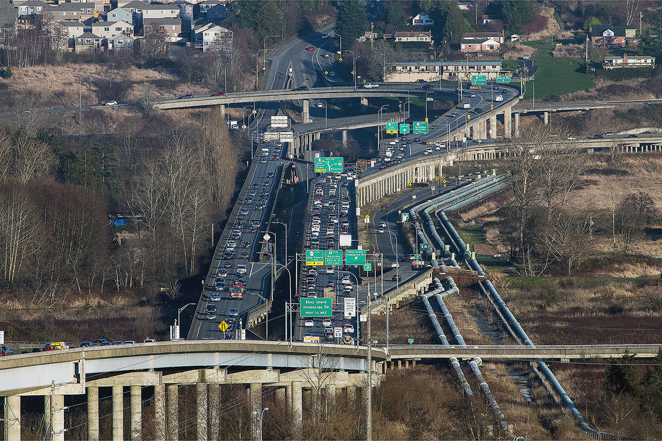 Looking east toward the U.S. 2 trestle as cars begin to backup on Thursday, March 1, 2018 in Everett, Wa. The aging westbound span needs replacing and local politicians are looking to federal dollars to get the replacement started. (Andy Bronson / The Herald)