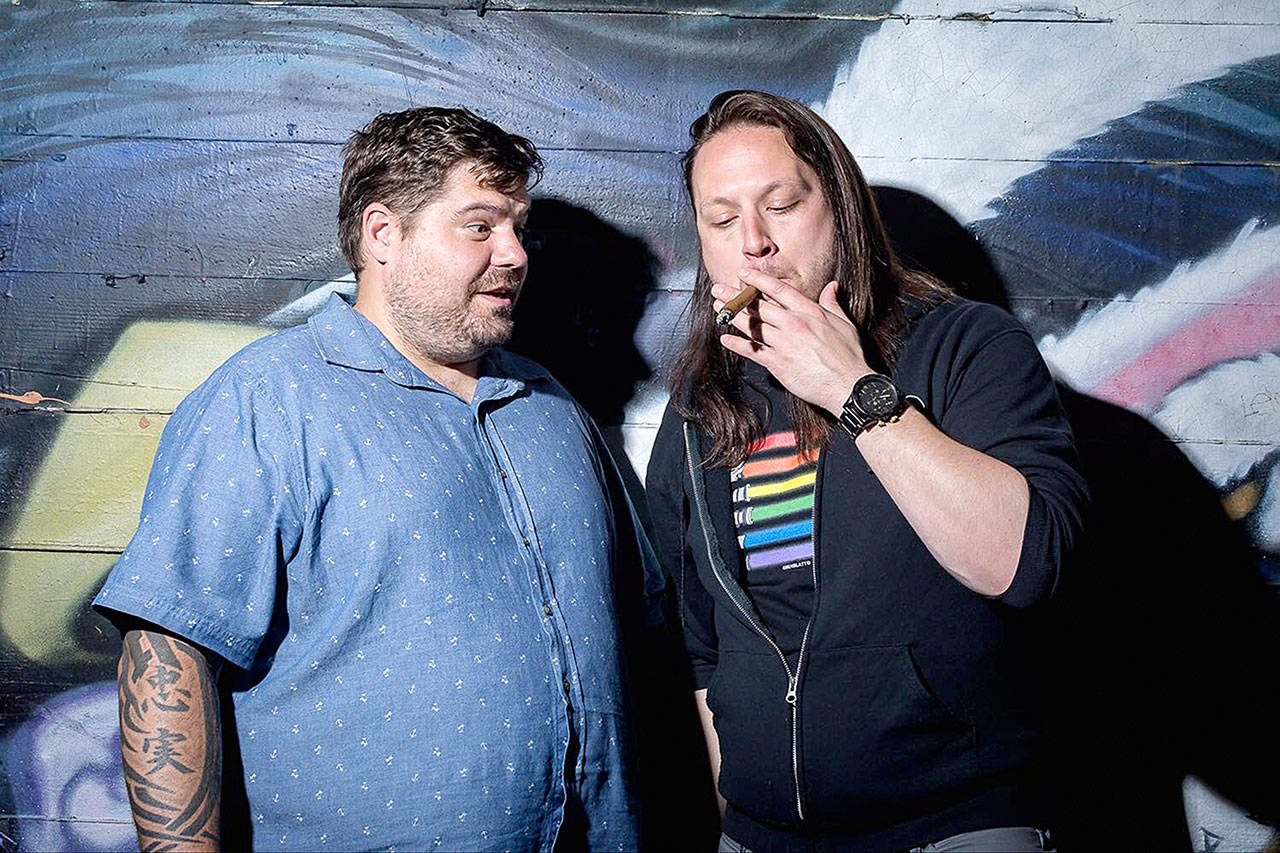 """Mitch Burrow (left) and Tyler Smith smoke marijuana before performing in """"The Dope Show."""" The next one is scheduled for Nov. 20 at the Historic Everett Theatre. (Gabriel Michael)"""