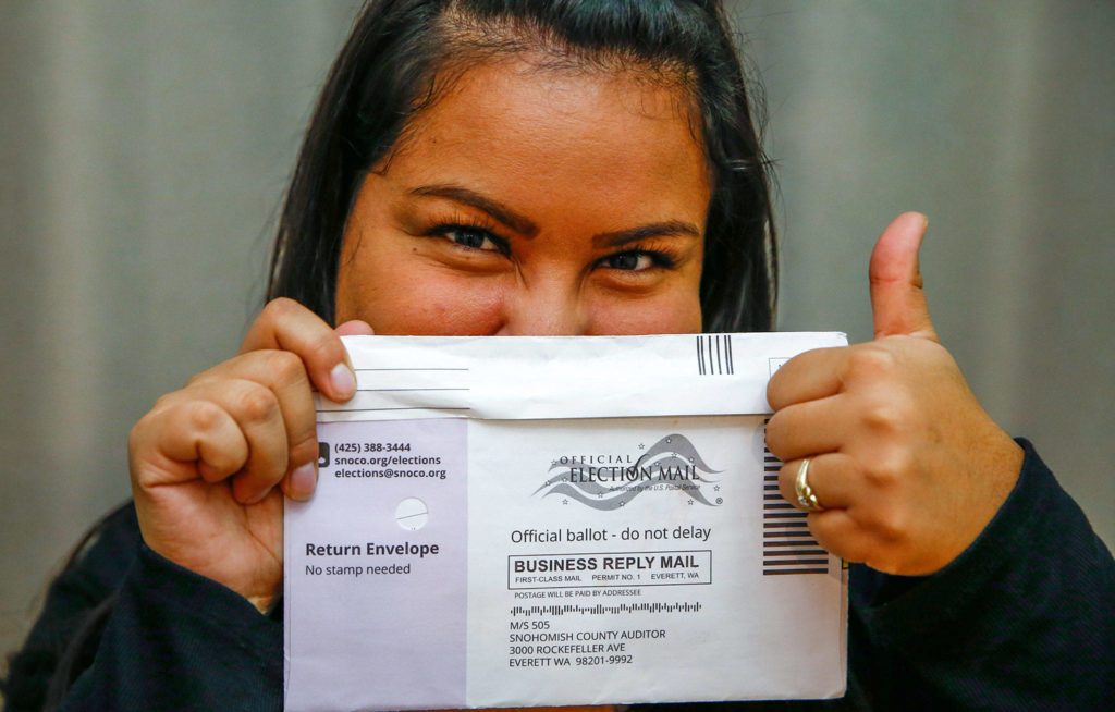 Jessica Figueroa, 27, a new United States citizen voting in her first election, says she is casting a vote that is the voice of her household. (Kevin Clark / The Herald)