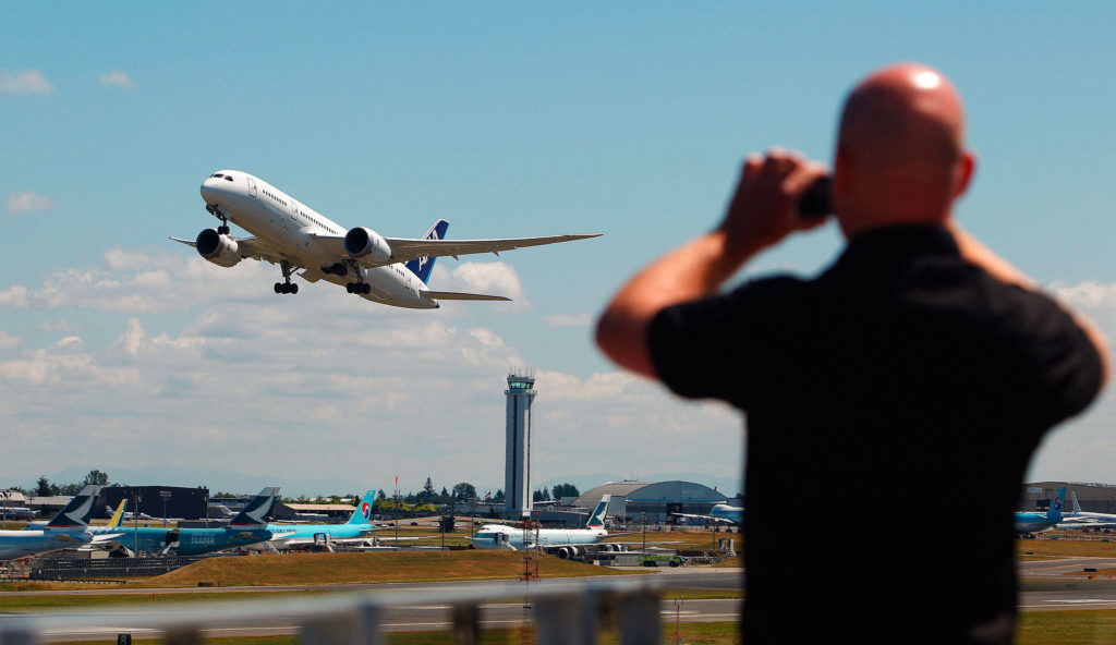 Mark Mulligan / Herald file Alan Evans, visiting the Future of Flight Museum from Manchester, England, photographs a Boeing 787 lifting off the runway at Paine Field from the museum's observation deck on July 29, 2011.