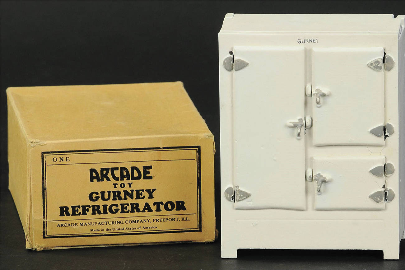 "This toy refrigerator can be dated by the square section that held a block of ice, an early type used from the 1840s. It sold at auction in ""unplayed with"" condition with a pristine box for more than $1,000. (Cowles Syndicate Inc.)"