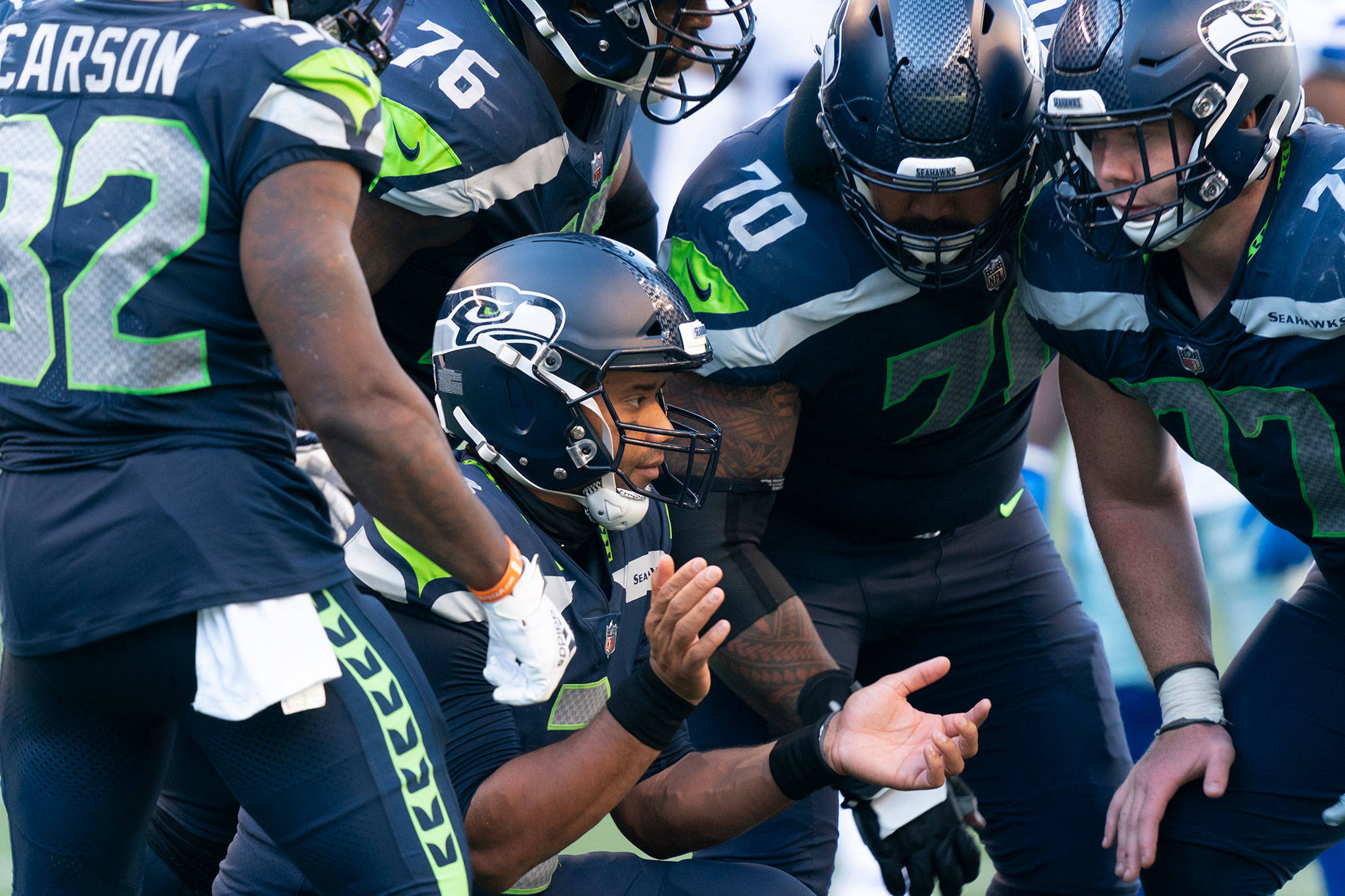 Seahawks quarterback Russell Wilson breaks the huddle during the second half of a game against the Cowboys on Sept. 27, 2020, in Seattle. (AP Photo/Stephen Brashear)