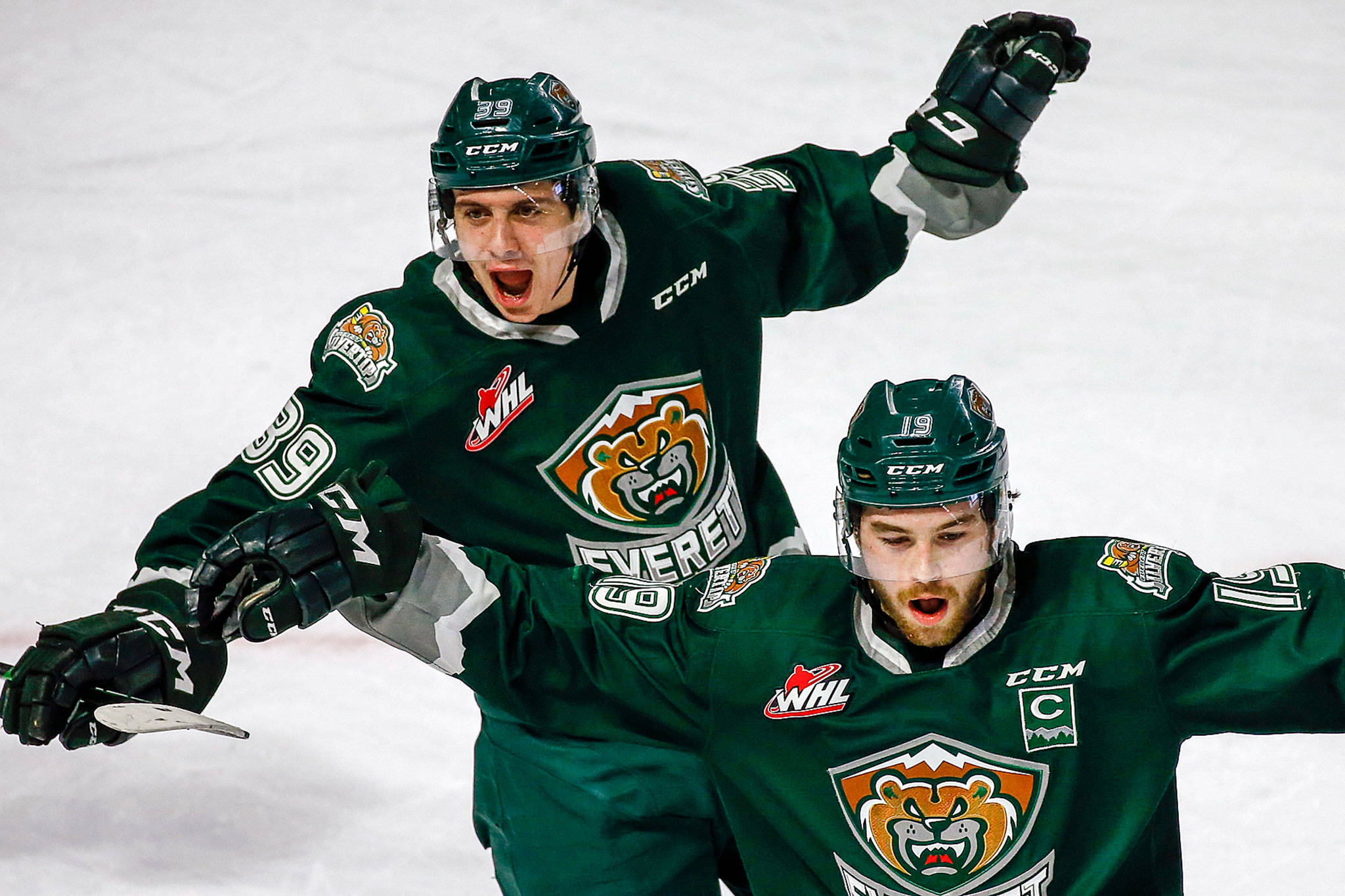 The Silvertips' Gage Goncalves (left) and Bryce Kindopp celebrate a goal against Seattle during a game on March 8, 2020, in Kent. (Kevin Clark / The Herald)